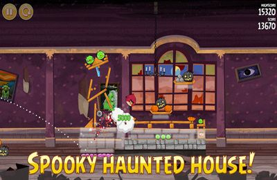 iPhone、iPad または iPod 用Angry Birds Seasons: Haunted hogsゲームのスクリーンショット。