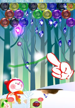 Скриншот игры Magic Finger: Christmas Bubble на Айфон.