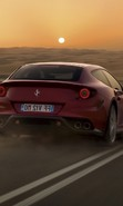 Download free mobile wallpaper 48949: Auto,Roads,Ferrari,Landscape,Desert,Transport,Sunset for phone or tab. Download images, backgrounds and wallpapers for mobile phone for free.