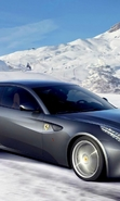 Download free mobile wallpaper 46437: Auto,Ferrari,Mountains,Landscape,Snow,Transport,Winter for phone or tab. Download images, backgrounds and wallpapers for mobile phone for free.