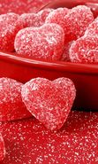 Download free mobile wallpaper 26645: Food, Background, Candies, Hearts for phone or tab. Download images, backgrounds and wallpapers for mobile phone for free.