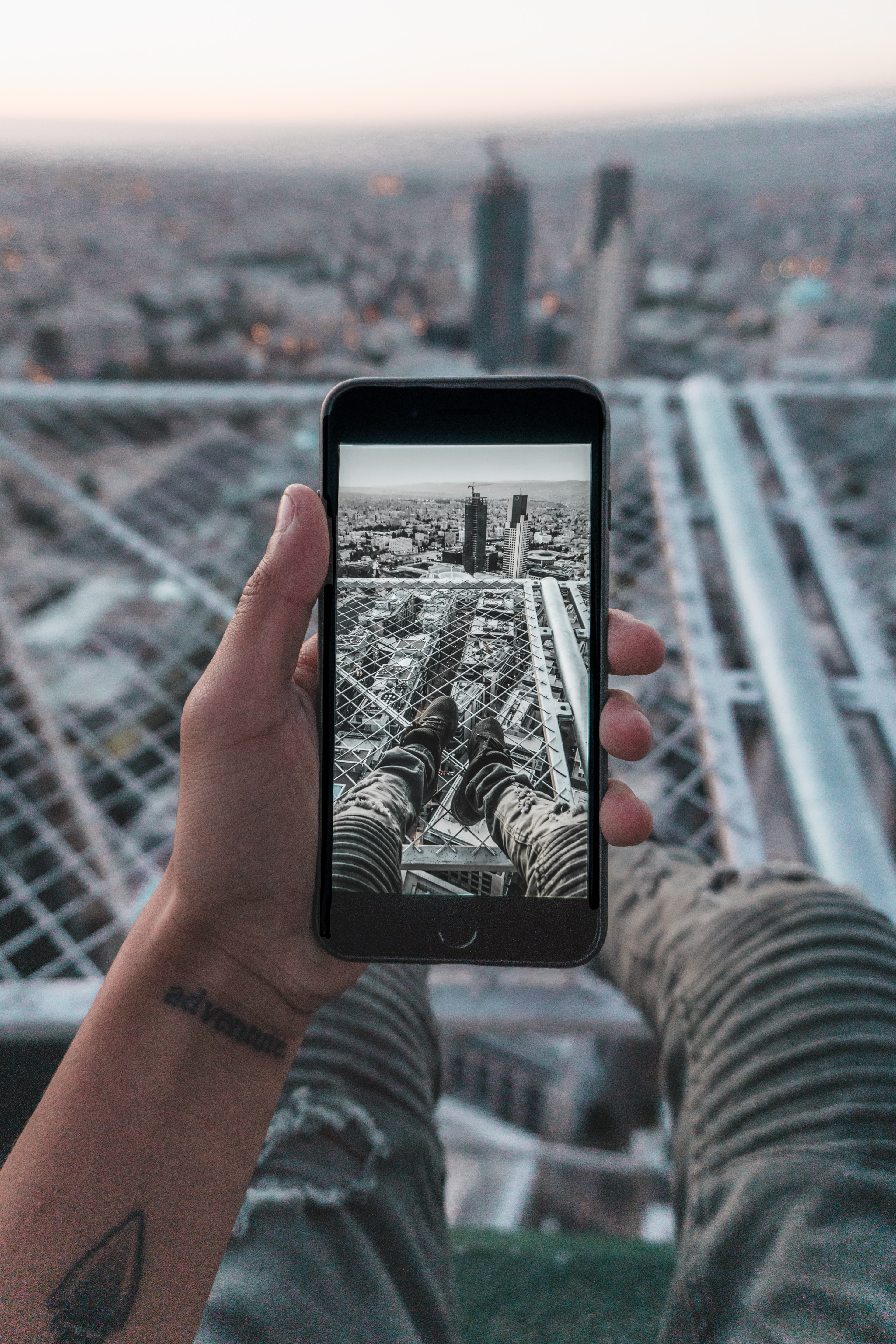 156326 Screensavers and Wallpapers Photo for phone. Download Miscellanea, Miscellaneous, Telephone, Hand, Photo, Roof, City, View From Above pictures for free