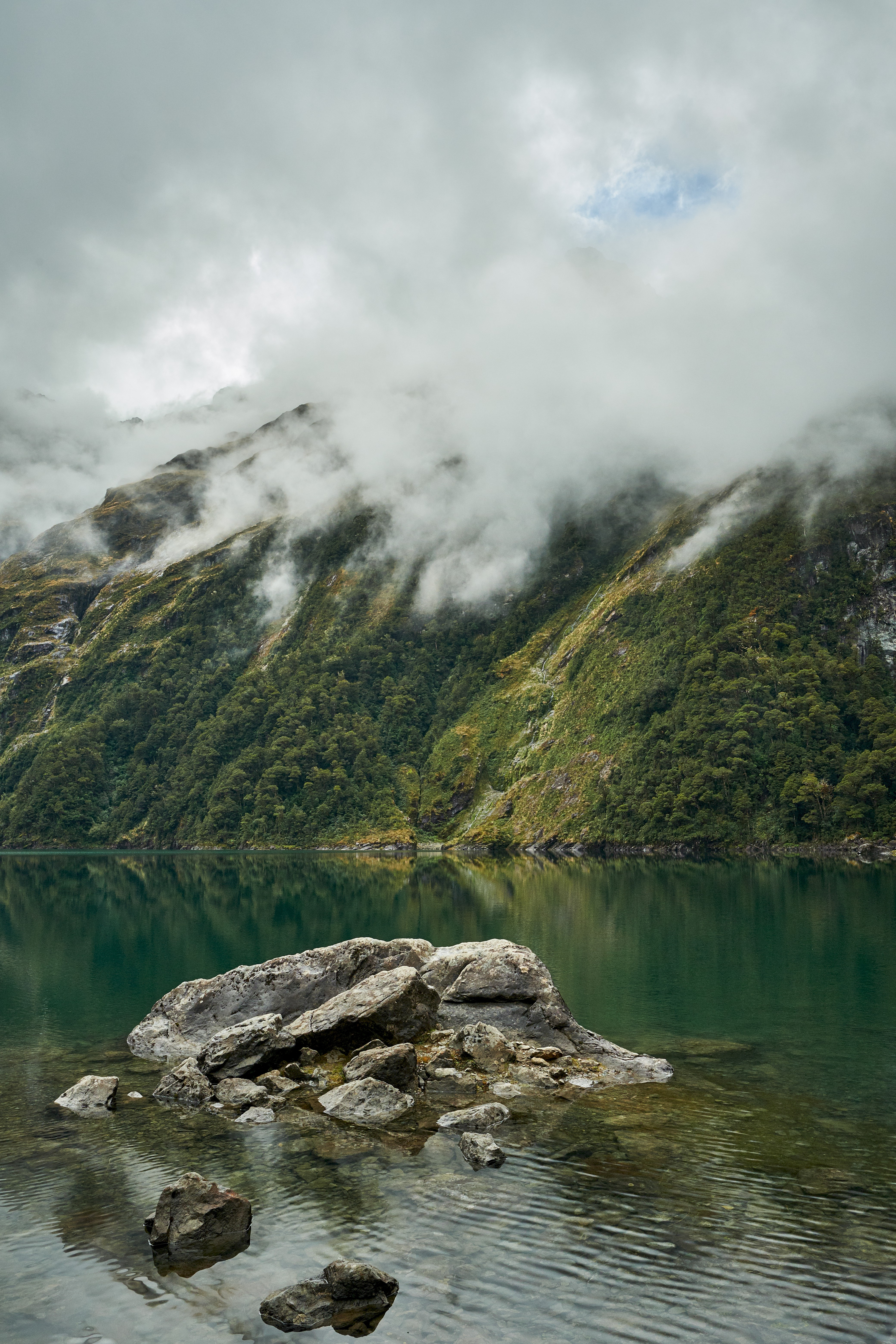 90256 Screensavers and Wallpapers New Zealand for phone. Download Nature, Rock, Rocks, Mountain, Lake, New Zealand, Fog, Stone pictures for free