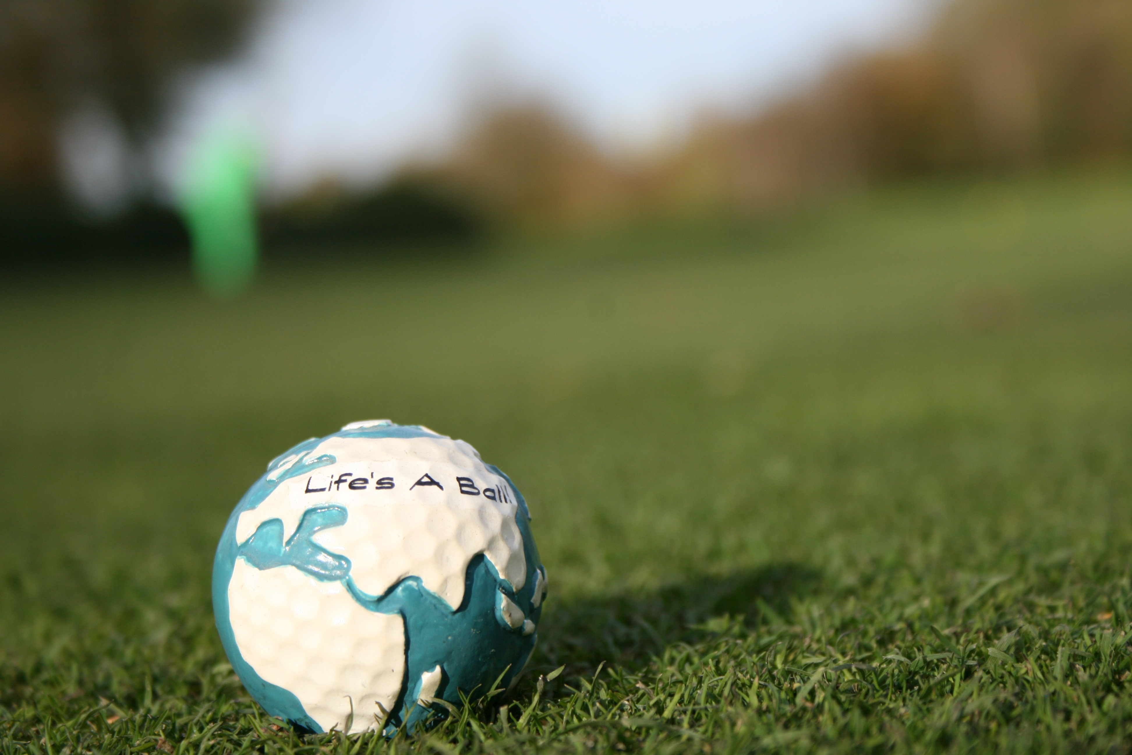 87060 download wallpaper Sports, Grass, Golf, Ball screensavers and pictures for free