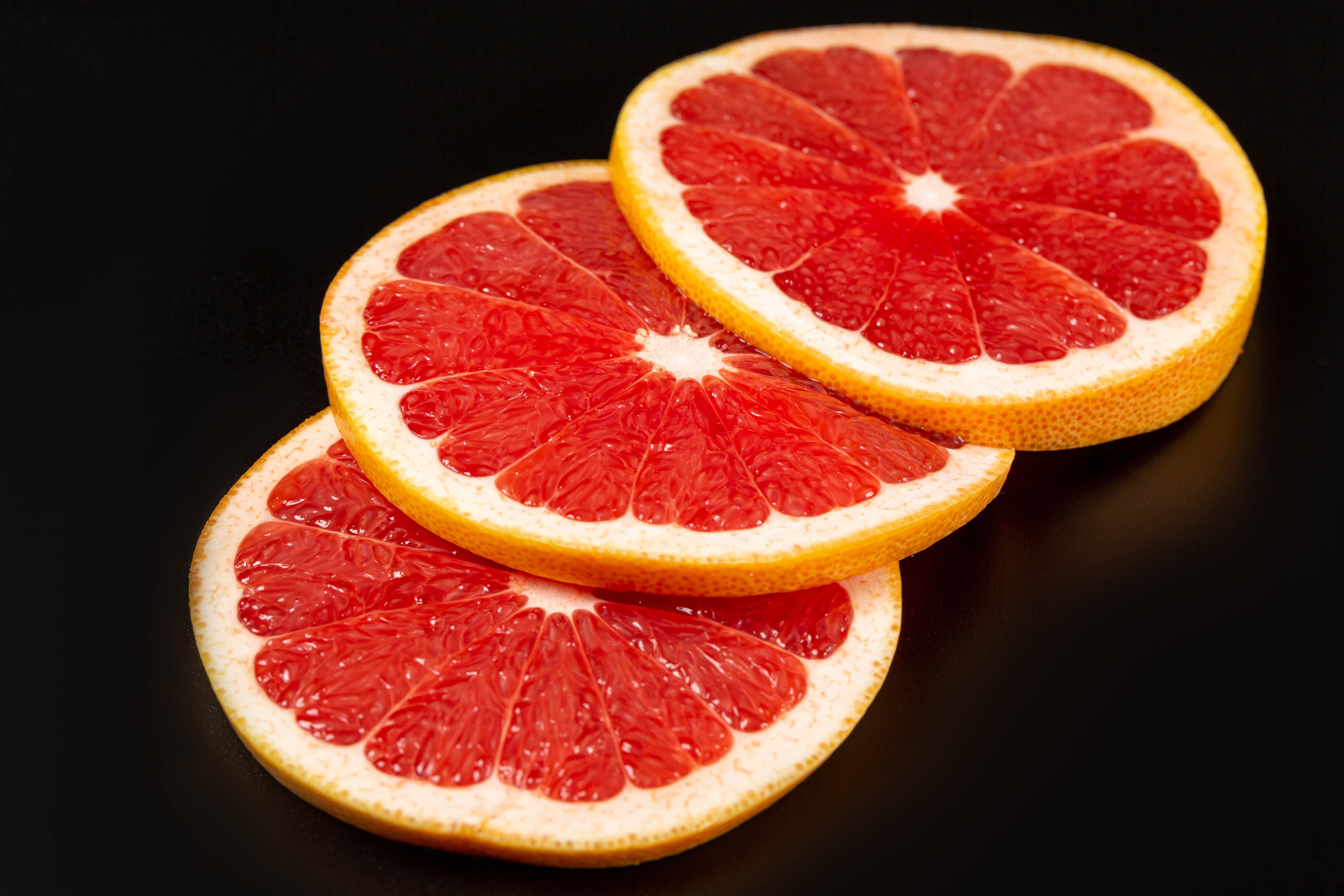 58969 download wallpaper Food, Fruit, Citrus, Lobules, Slices, Grapefruit screensavers and pictures for free