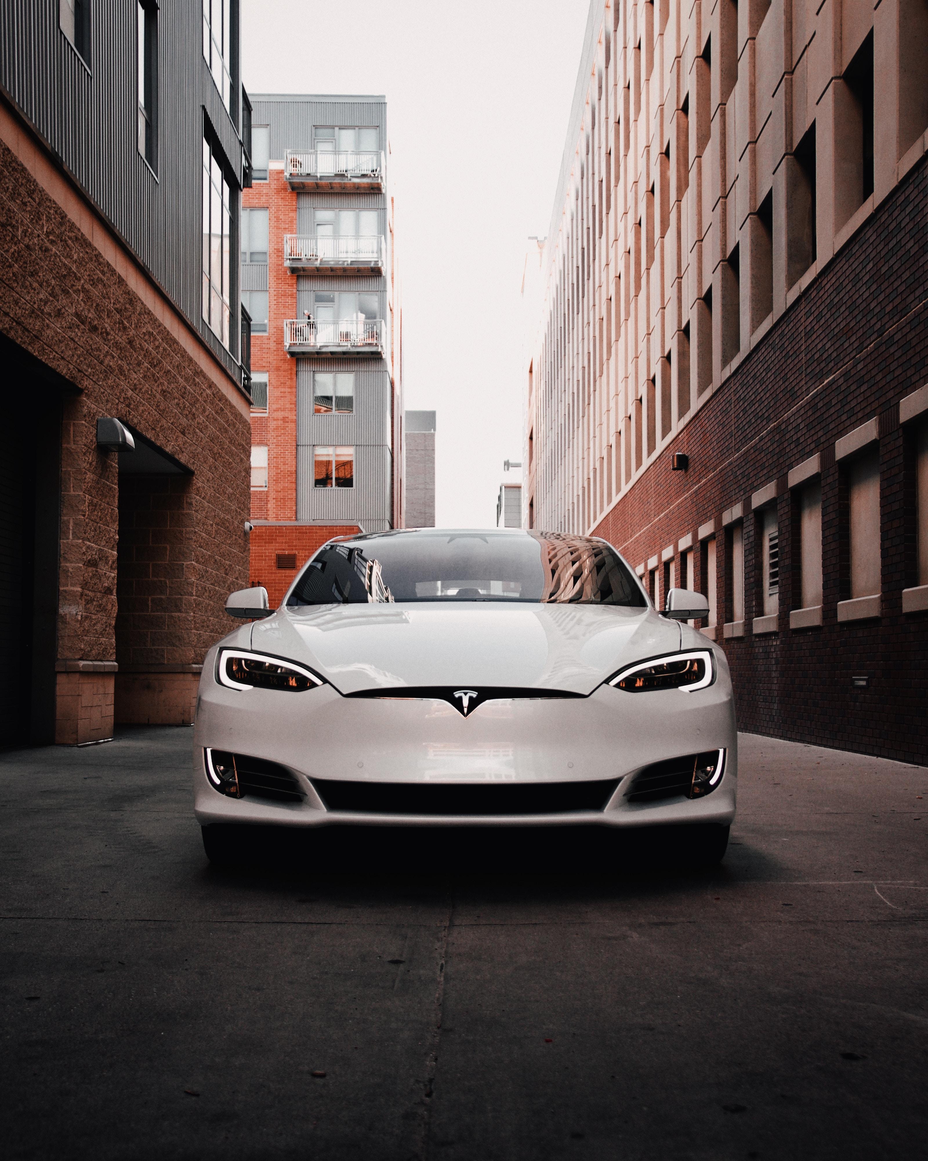 70937 Заставки и Обои Вид Спереди на телефон. Скачать Электрокар, Tesla, Tesla Model S, Тачки (Cars), Вид Спереди, Машина, Белый картинки бесплатно