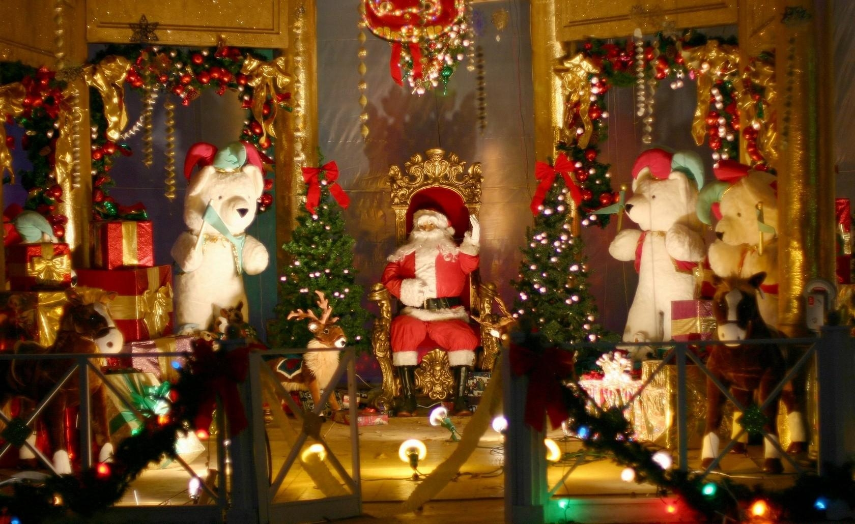 131503 download wallpaper Holidays, Santa Claus, Armchair, Bears, Toys, Presents, Gifts, Fencing, Enclosure, Decorations, Christmas, Fir-Trees screensavers and pictures for free