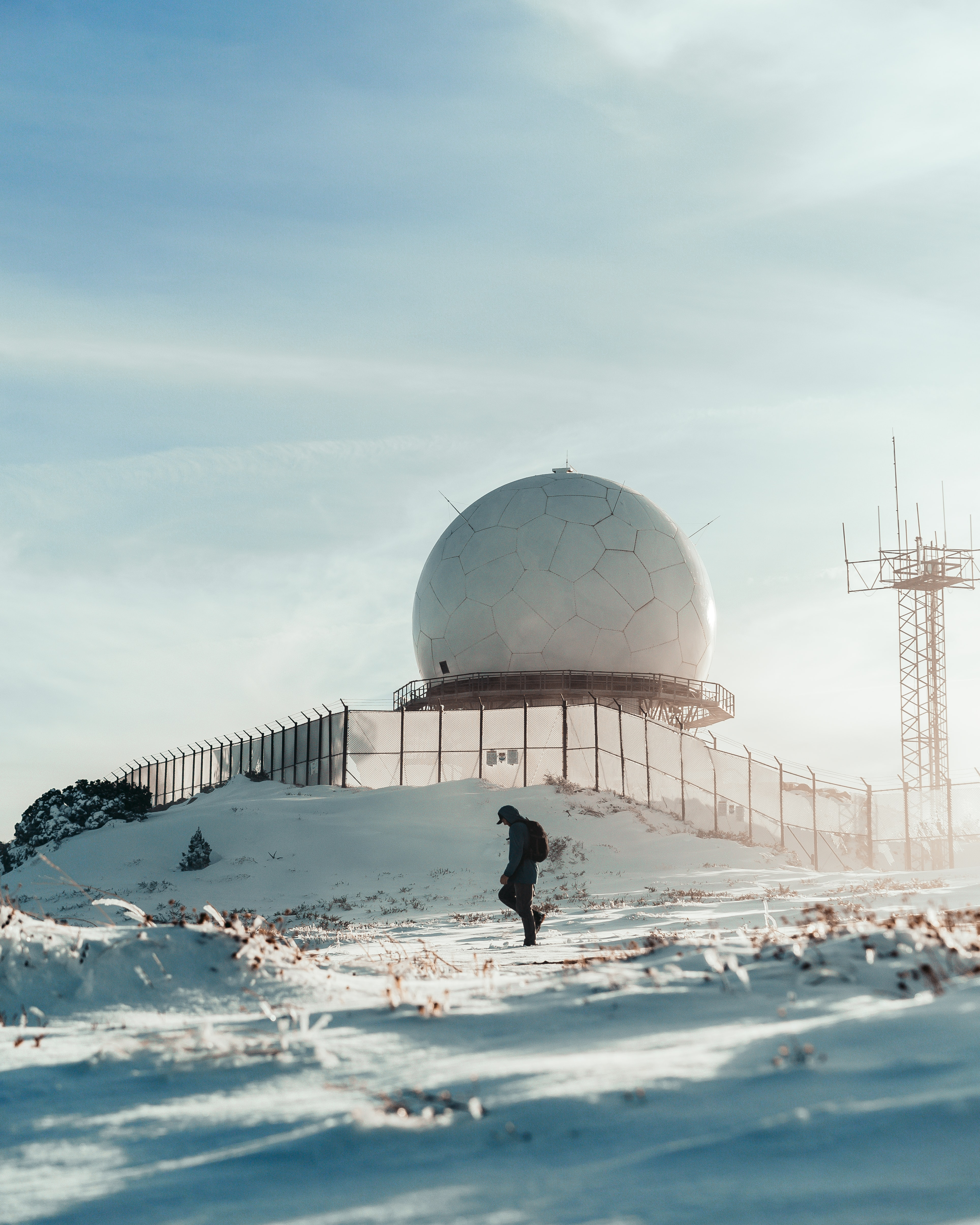 136296 download wallpaper Miscellanea, Miscellaneous, Human, Person, Loneliness, Building, Ball, Snow, Winter screensavers and pictures for free