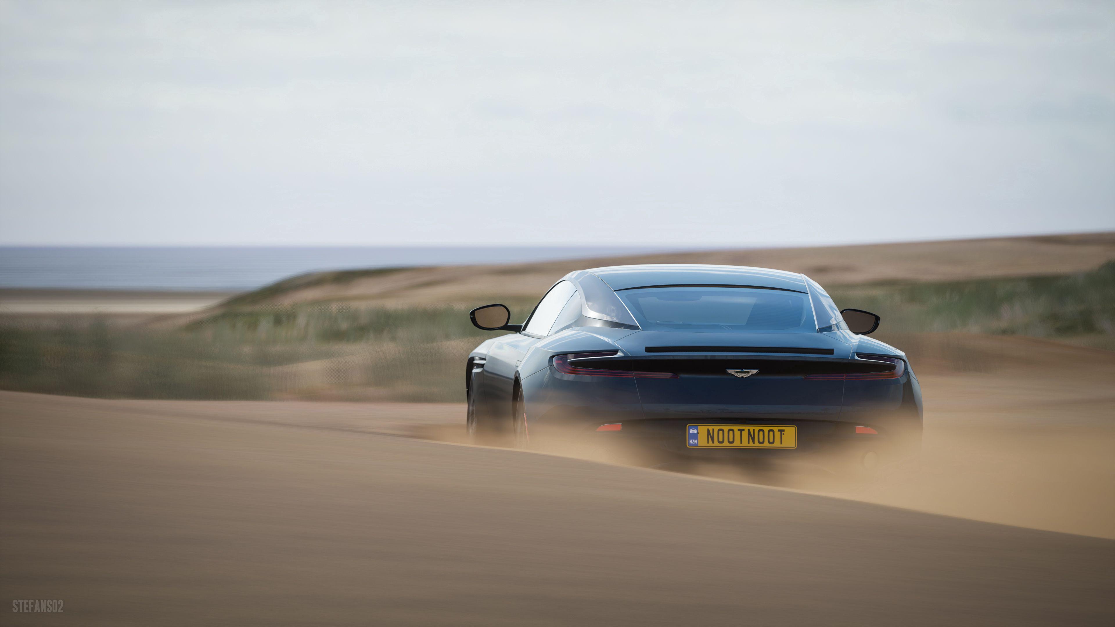 77751 Заставки и Обои Пустыня на телефон. Скачать Пустыня, Песок, Астон Мартин (Aston Martin), Тачки (Cars), Синий, Спорткар, Вид Сзади, Aston Martin Db11 картинки бесплатно
