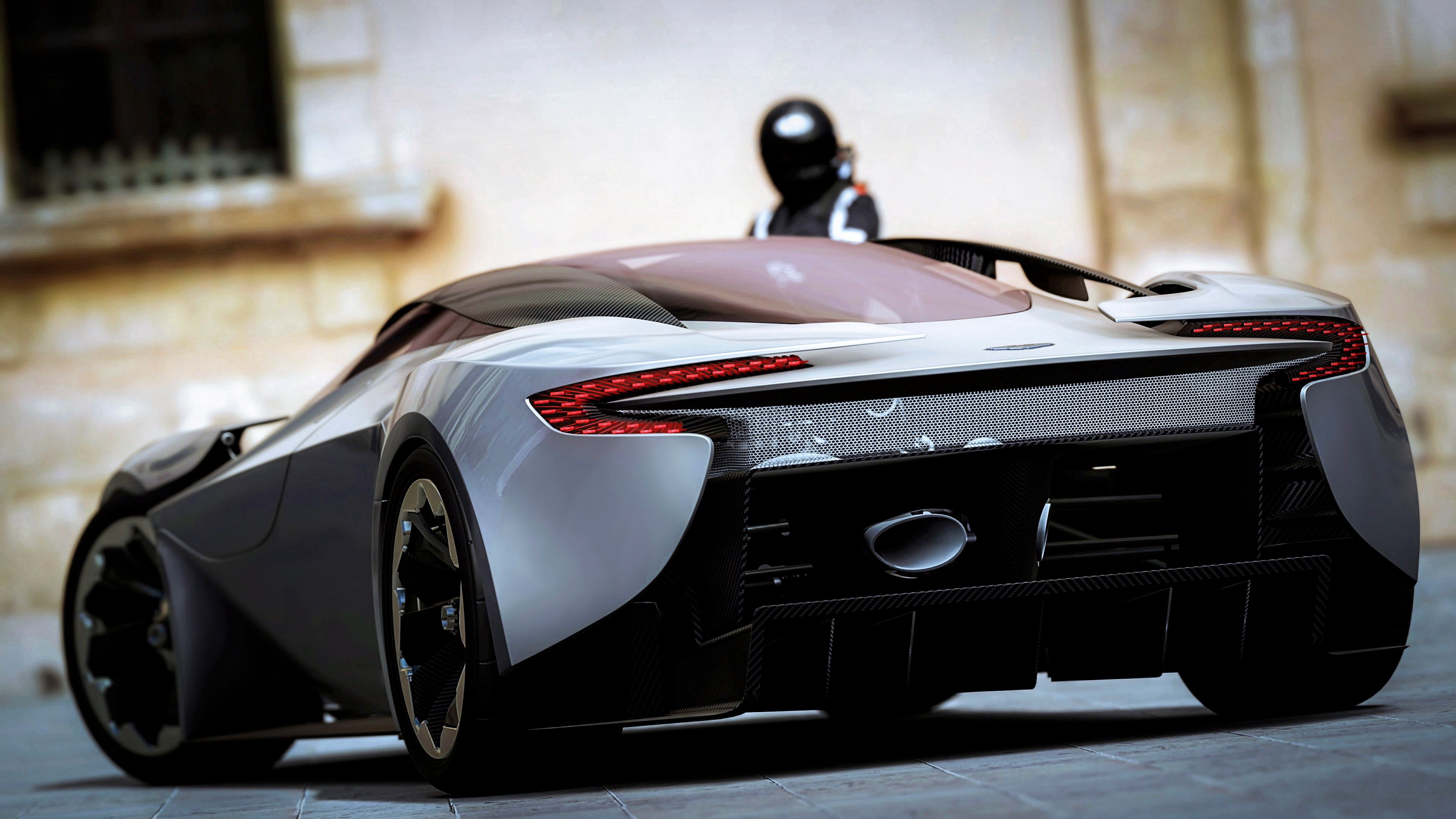 70669 download wallpaper Sports, Aston Martin, Cars, Sports Car, Back View, Rear View screensavers and pictures for free