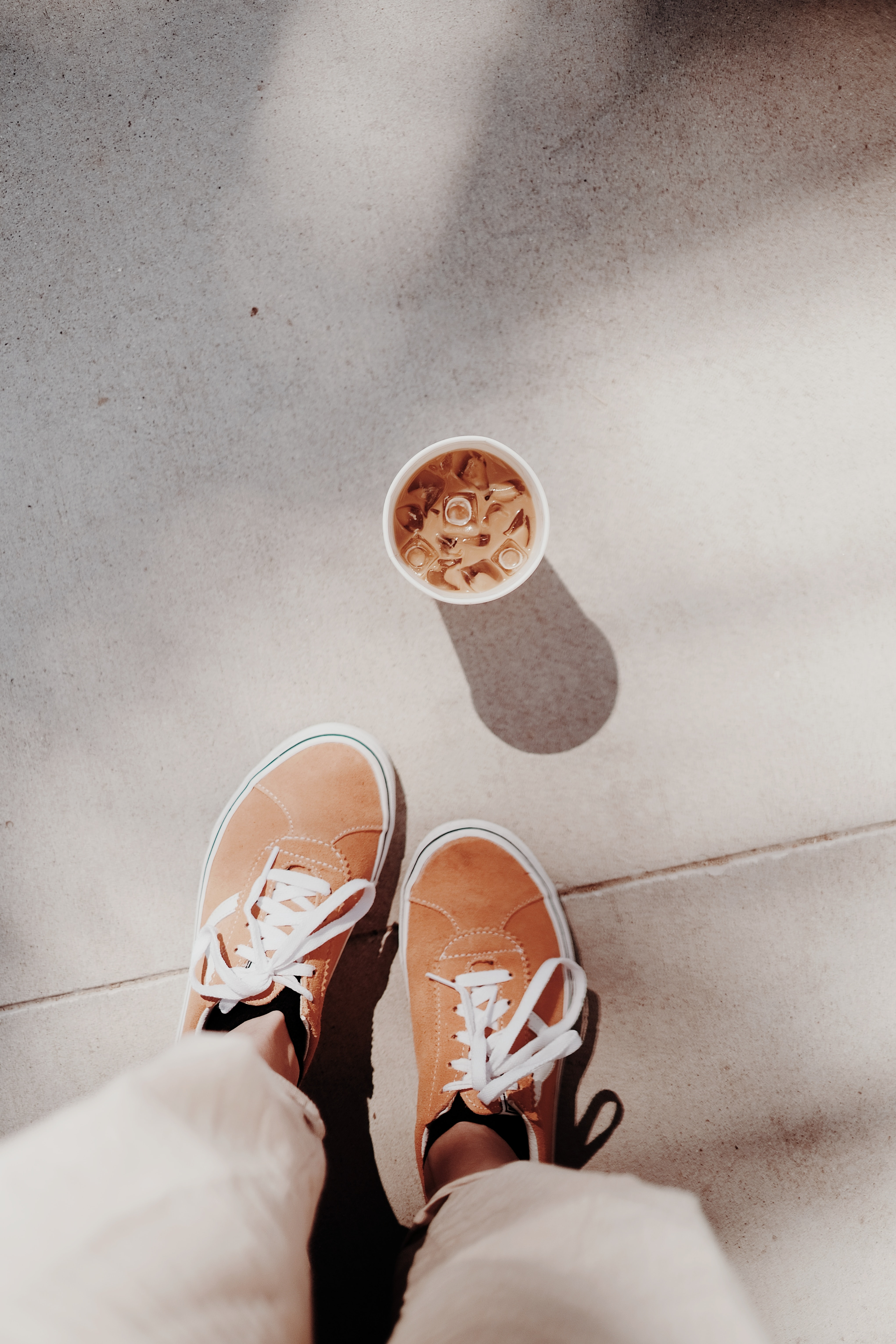 124848 download wallpaper Miscellanea, Miscellaneous, Coffee, Drink, Beverage, Legs, Sneakers, Shoes, Ice screensavers and pictures for free