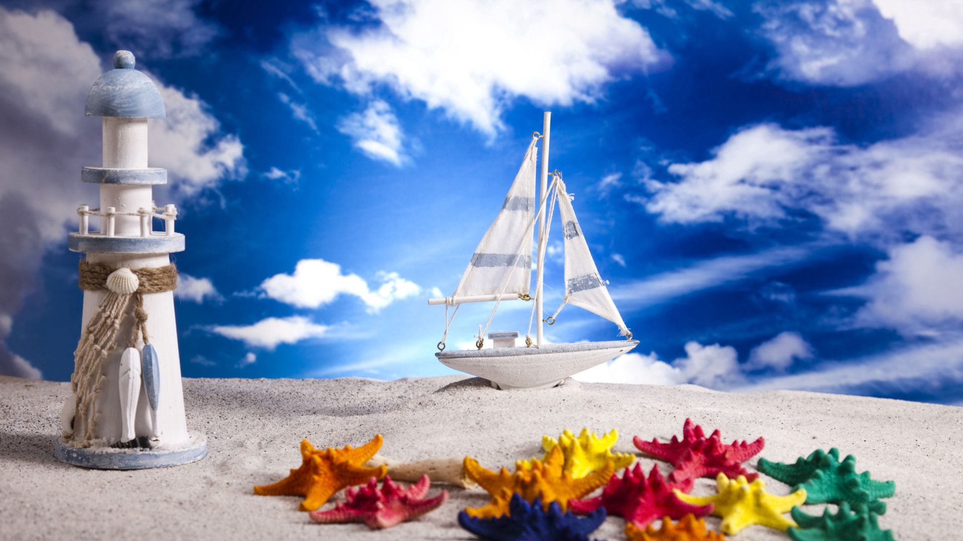 74050 download wallpaper Miscellanea, Miscellaneous, Sand, Layout, Ship, Nautilus, Lighthouse, Sea Stars, Starfish, Sky, Clouds screensavers and pictures for free
