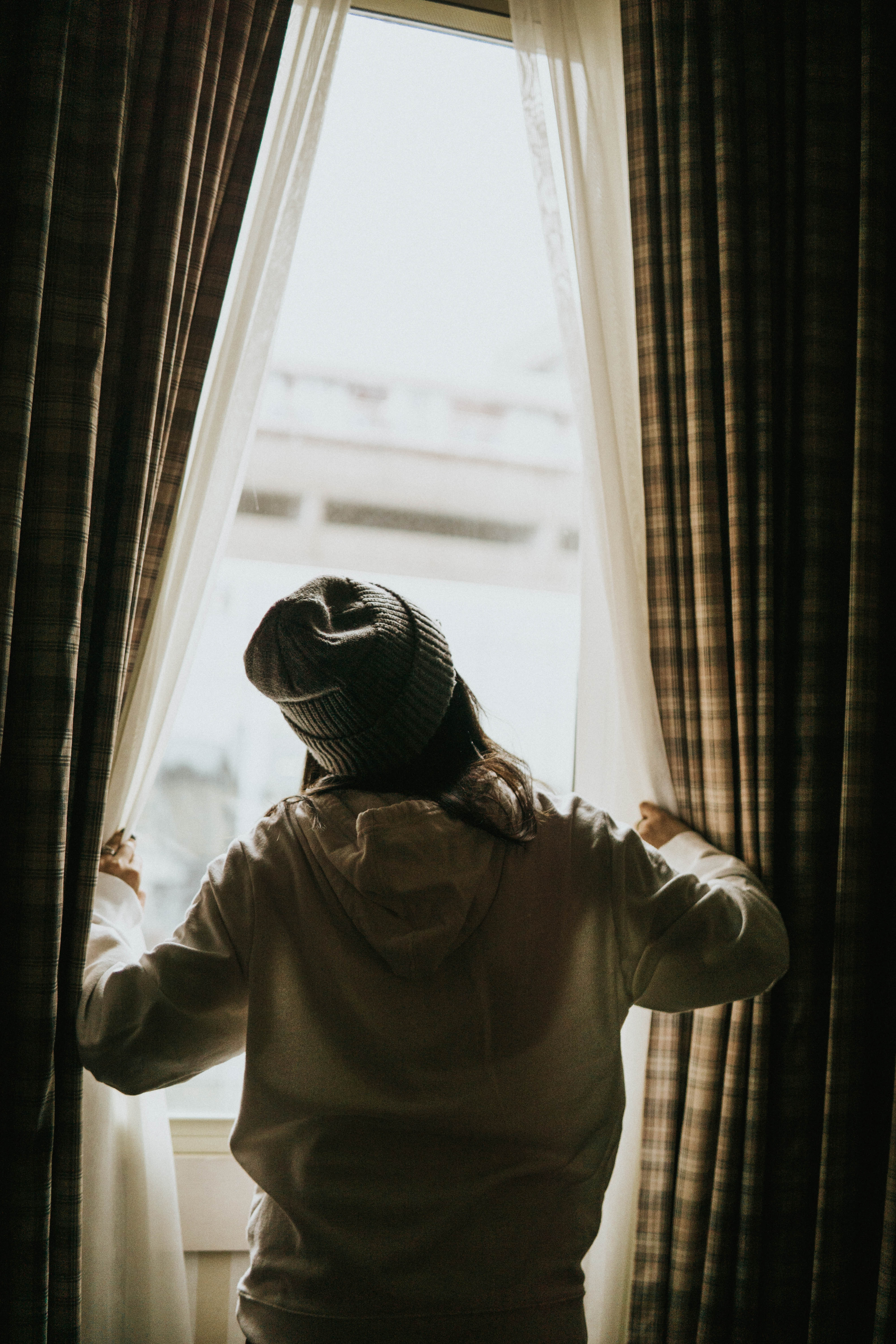 118053 download wallpaper Miscellanea, Miscellaneous, Silhouette, Curtains, Window, Look, Peek Out, Look Out screensavers and pictures for free