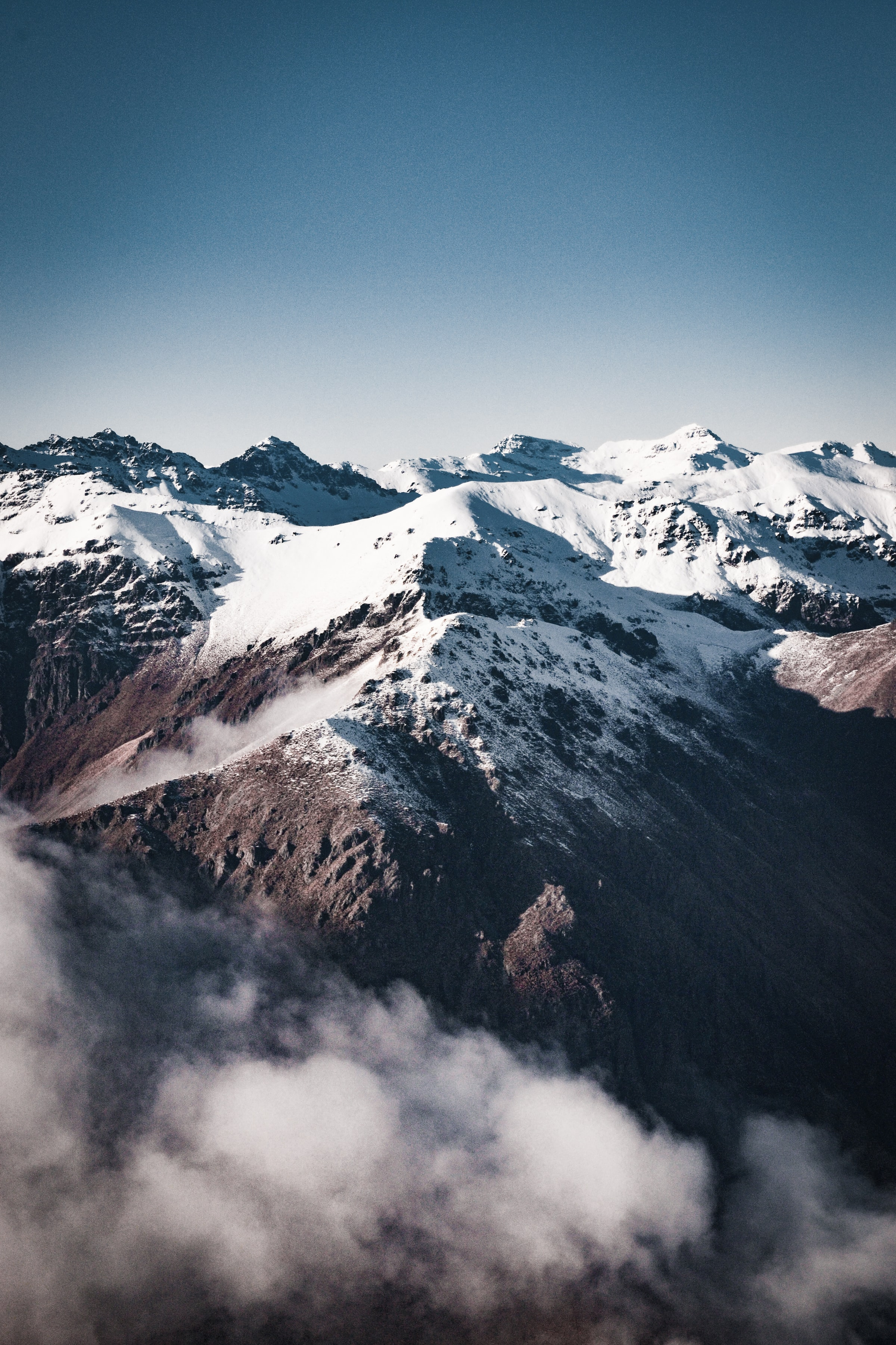 101430 download wallpaper Nature, Rocks, Snow, Snow Covered, Snowbound, Fog, Mountains screensavers and pictures for free