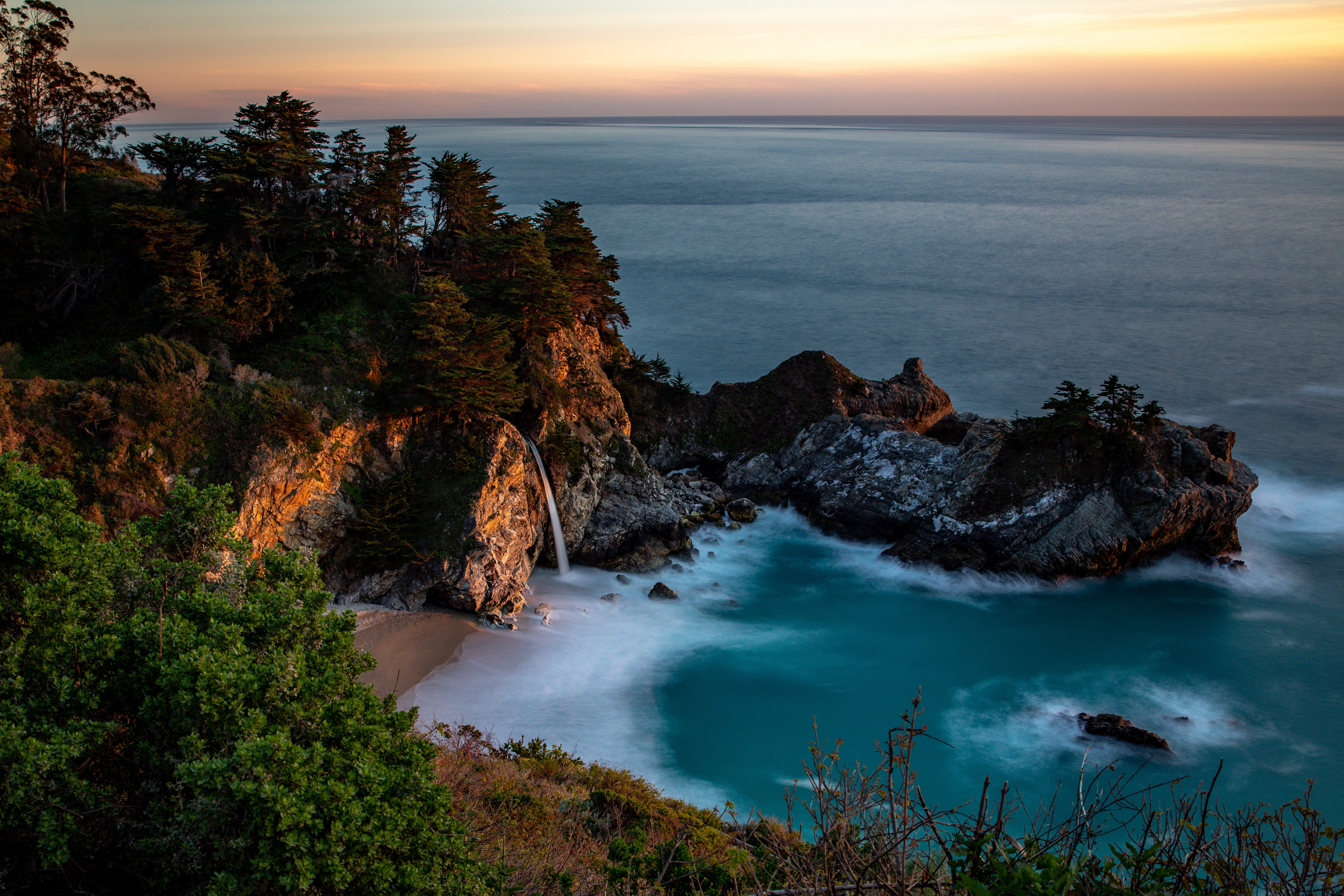 121981 download wallpaper Nature, Bay, Rocks, Waterfall, Sea, Trees, Vegetation, Stone screensavers and pictures for free