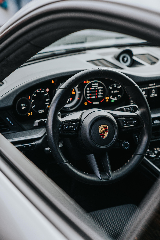 104301 скачать обои Тачки (Cars), Порш (Porsche), Автомобиль, Серый, Руль, Управление, Салон - заставки и картинки бесплатно