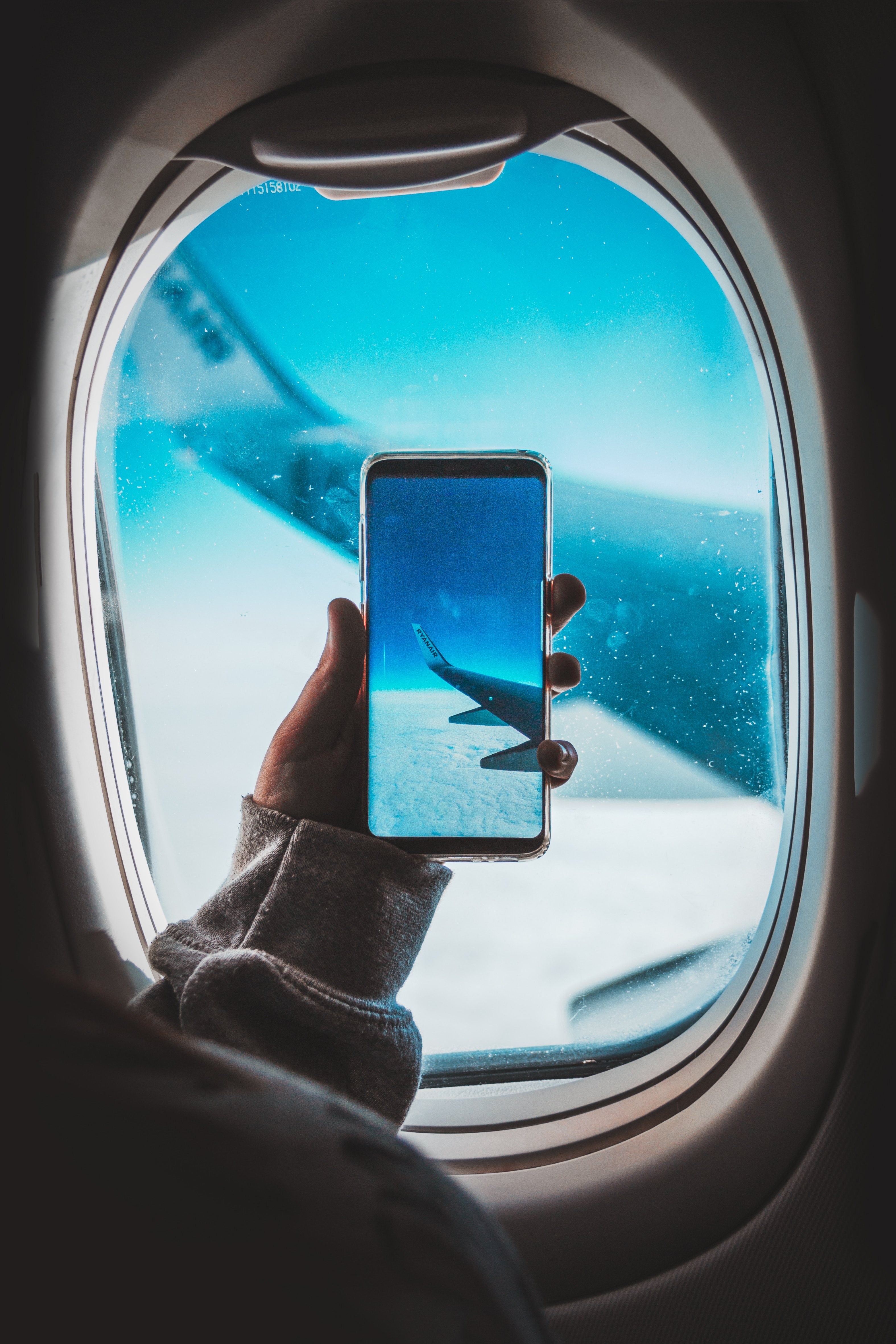 153116 Screensavers and Wallpapers Hand for phone. Download Miscellanea, Miscellaneous, Porthole, Plane, Airplane, Wing, Hand, Smartphone pictures for free