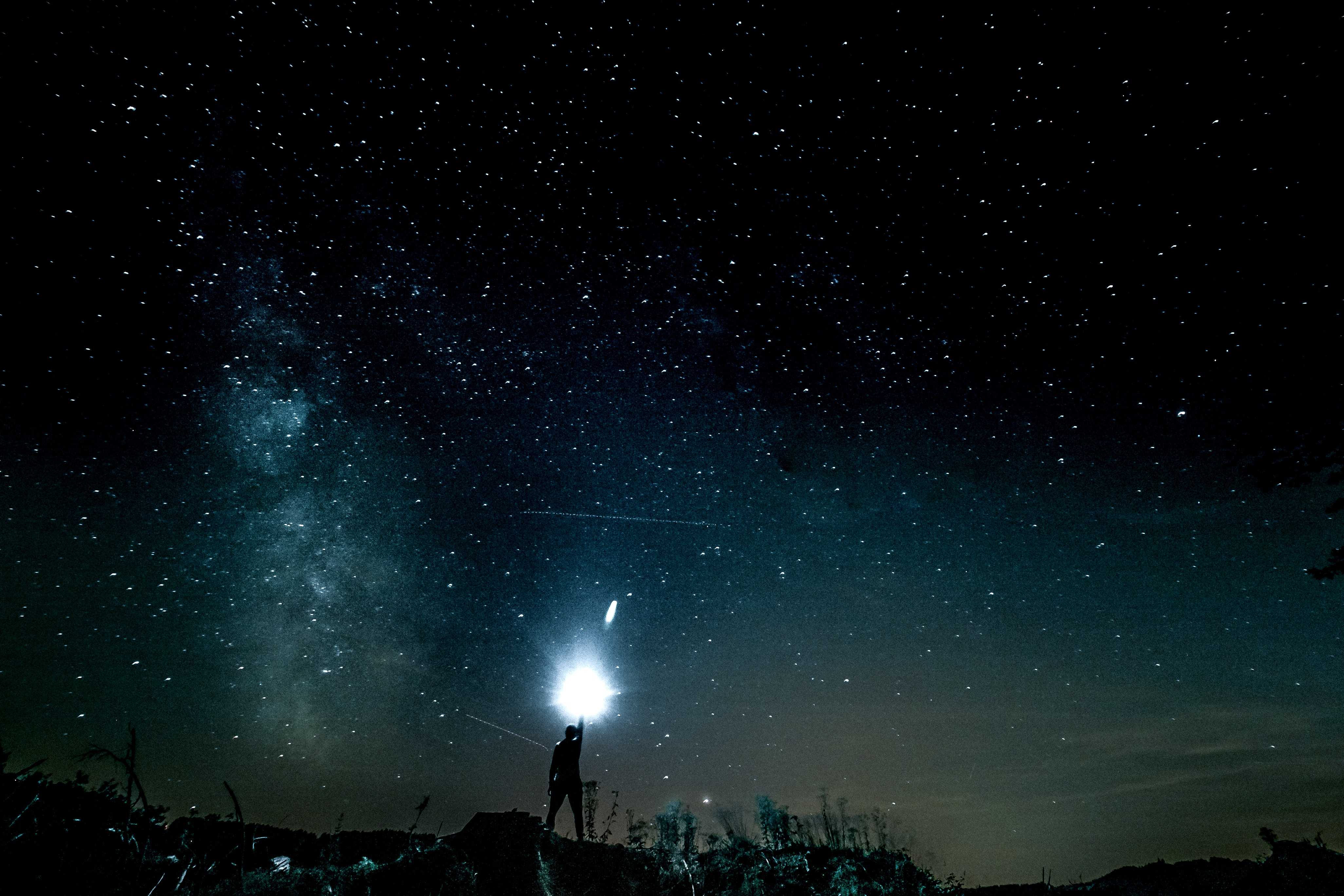 114731 download wallpaper Light, Nature, Shine, Starry Sky, Brilliance, Human, Person screensavers and pictures for free