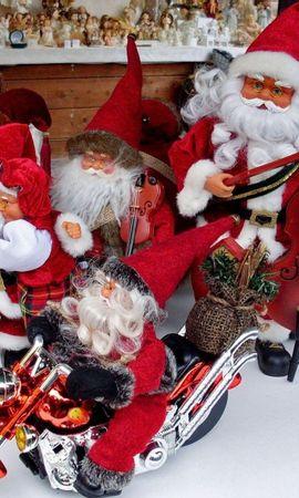 129799 descargar fondo de pantalla Vacaciones, Papá Noel, Claus De Papá Noel, Día Festivo, Navidad, Juguetes, Motocicleta: protectores de pantalla e imágenes gratis