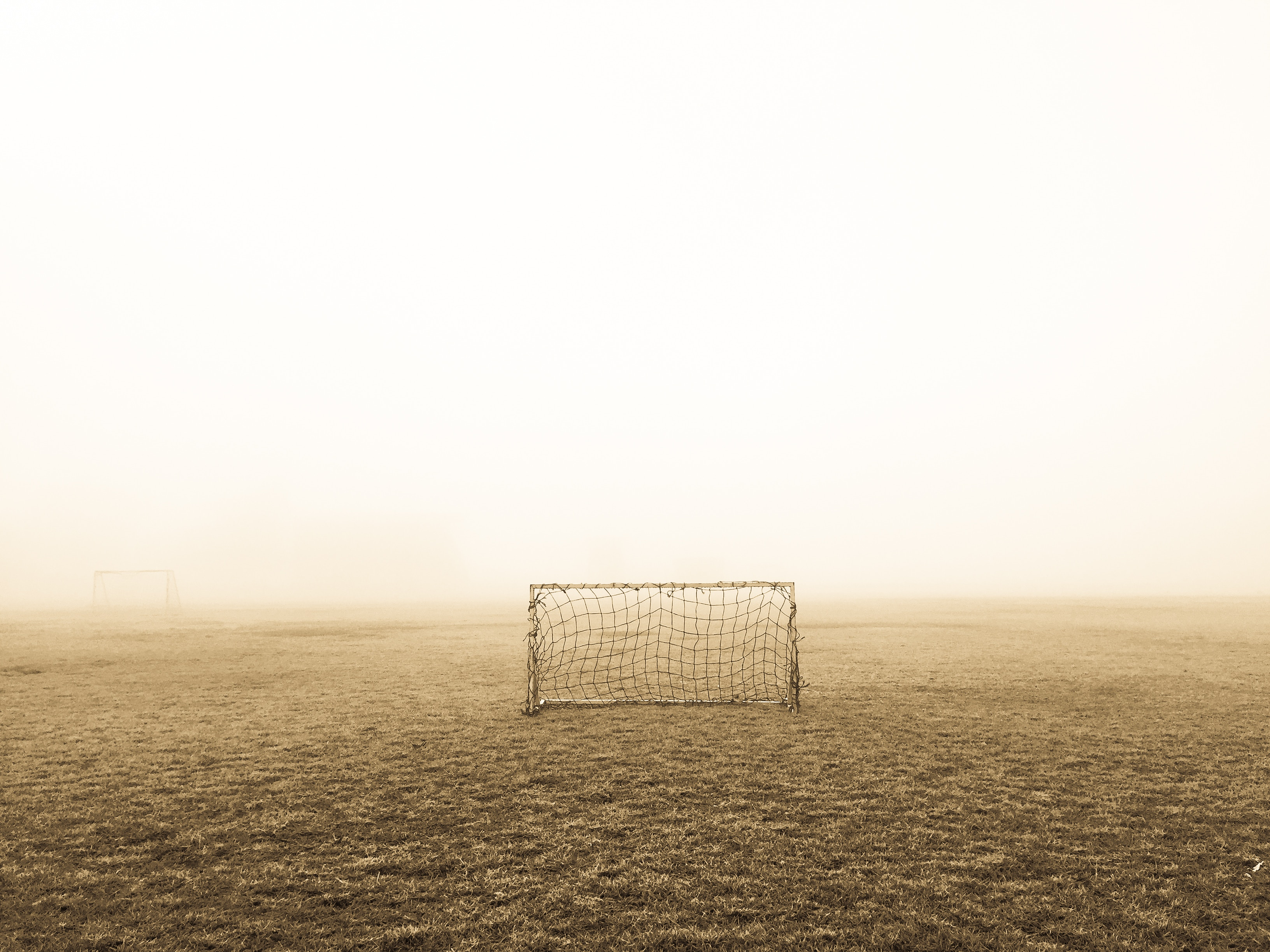 155438 download wallpaper Football, Sports, Fog, Loneliness, Lawn, Gate, Goal screensavers and pictures for free