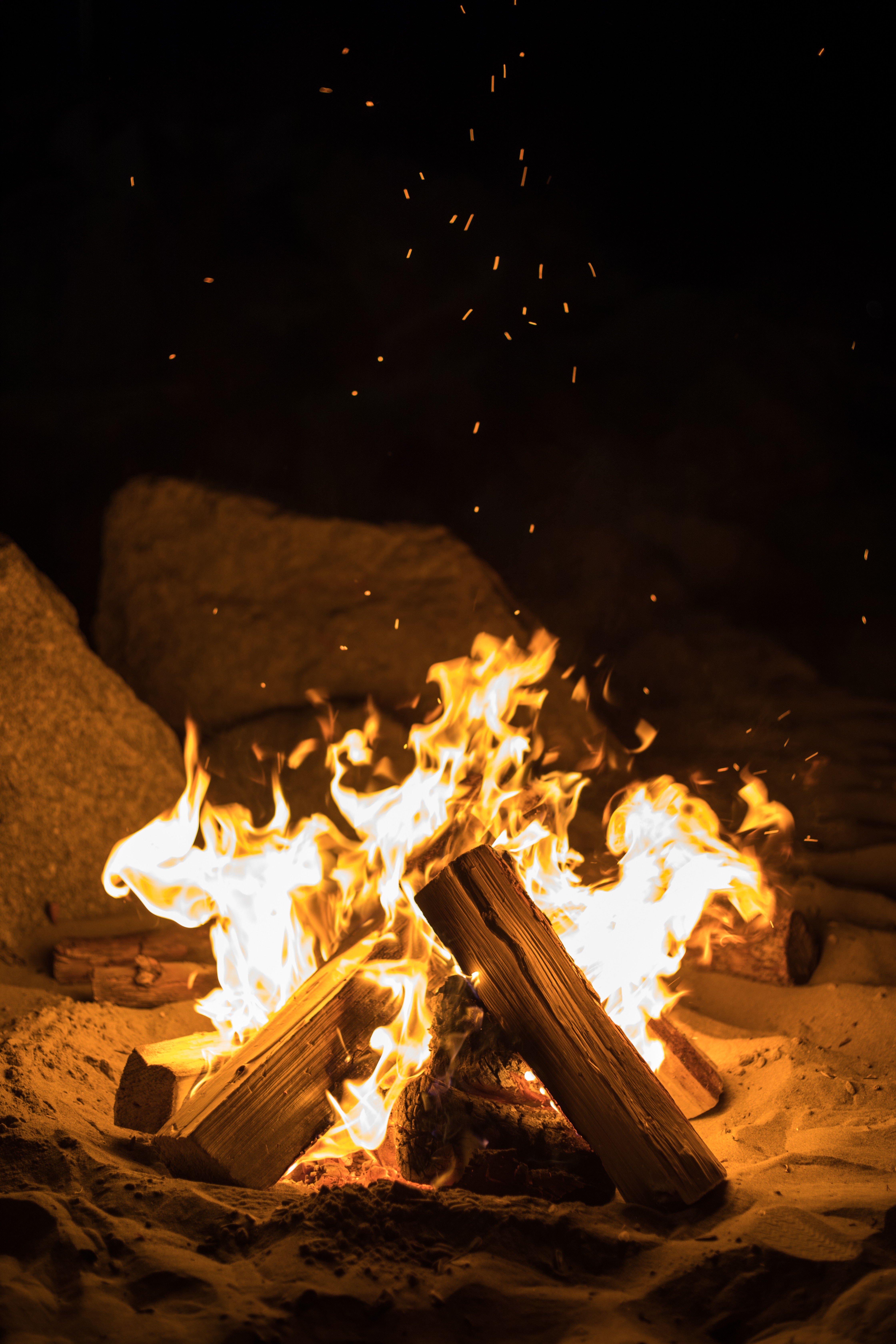 80137 Screensavers and Wallpapers Bonfire for phone. Download Fire, Bonfire, Night, Dark, Flame, Sparks, Firewood pictures for free