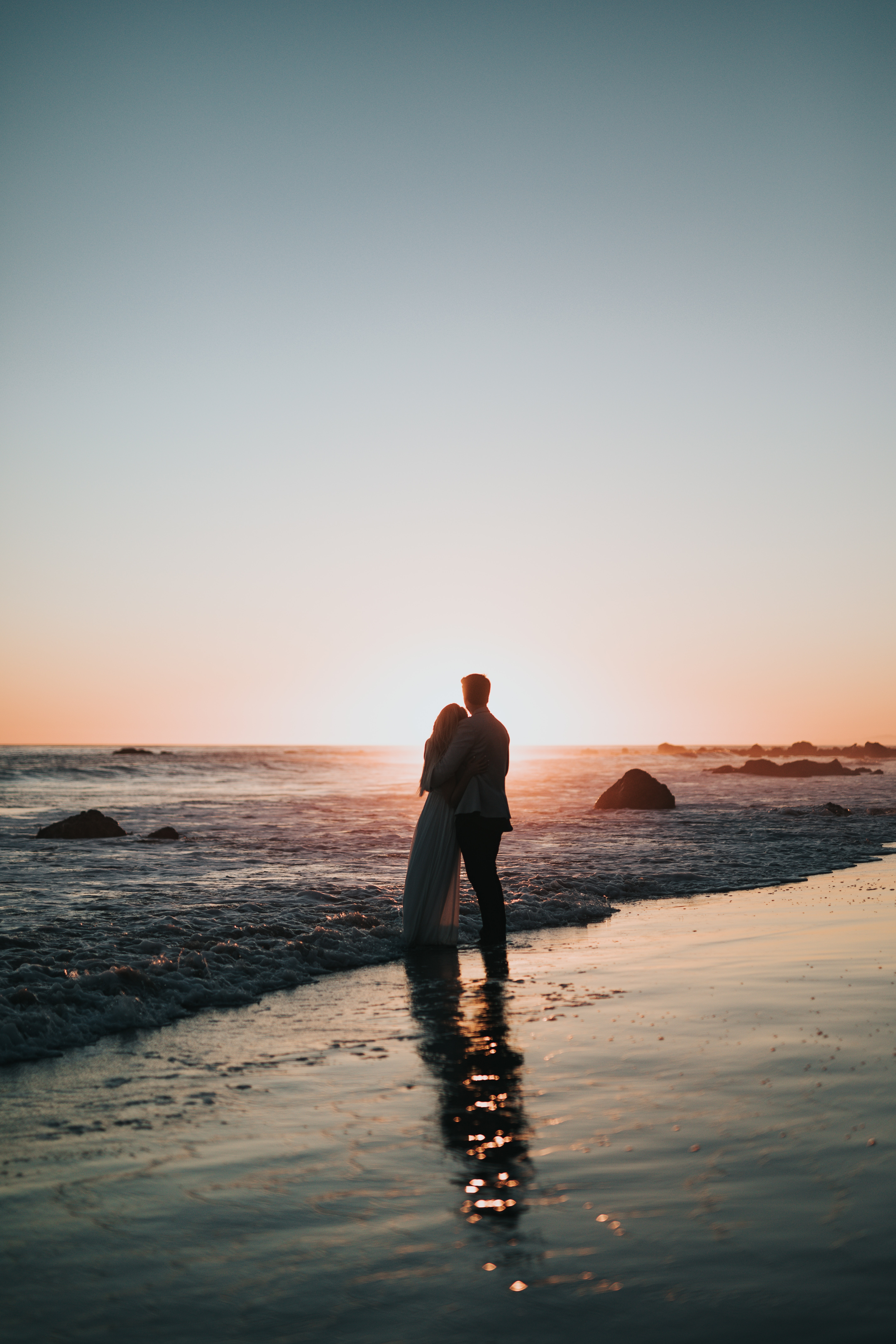 67137 download wallpaper Couple, Pair, Shore, Bank, Sunset, Embrace, Love screensavers and pictures for free