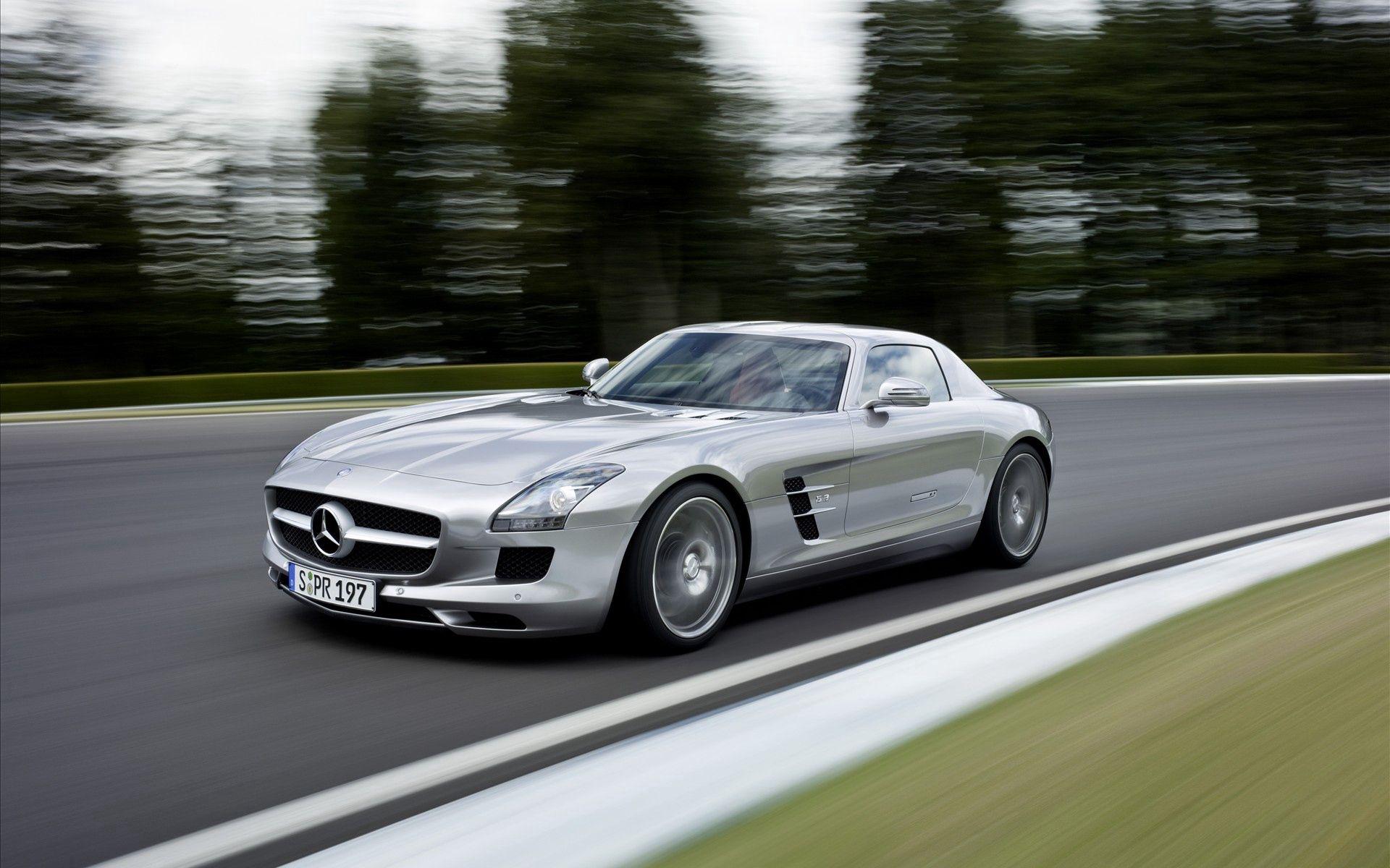 90038 скачать обои Мерседес (Mercedes), Тачки (Cars), Дорога, Серый, Скорость, Mercedes-Benz, Размытый, Sls - заставки и картинки бесплатно