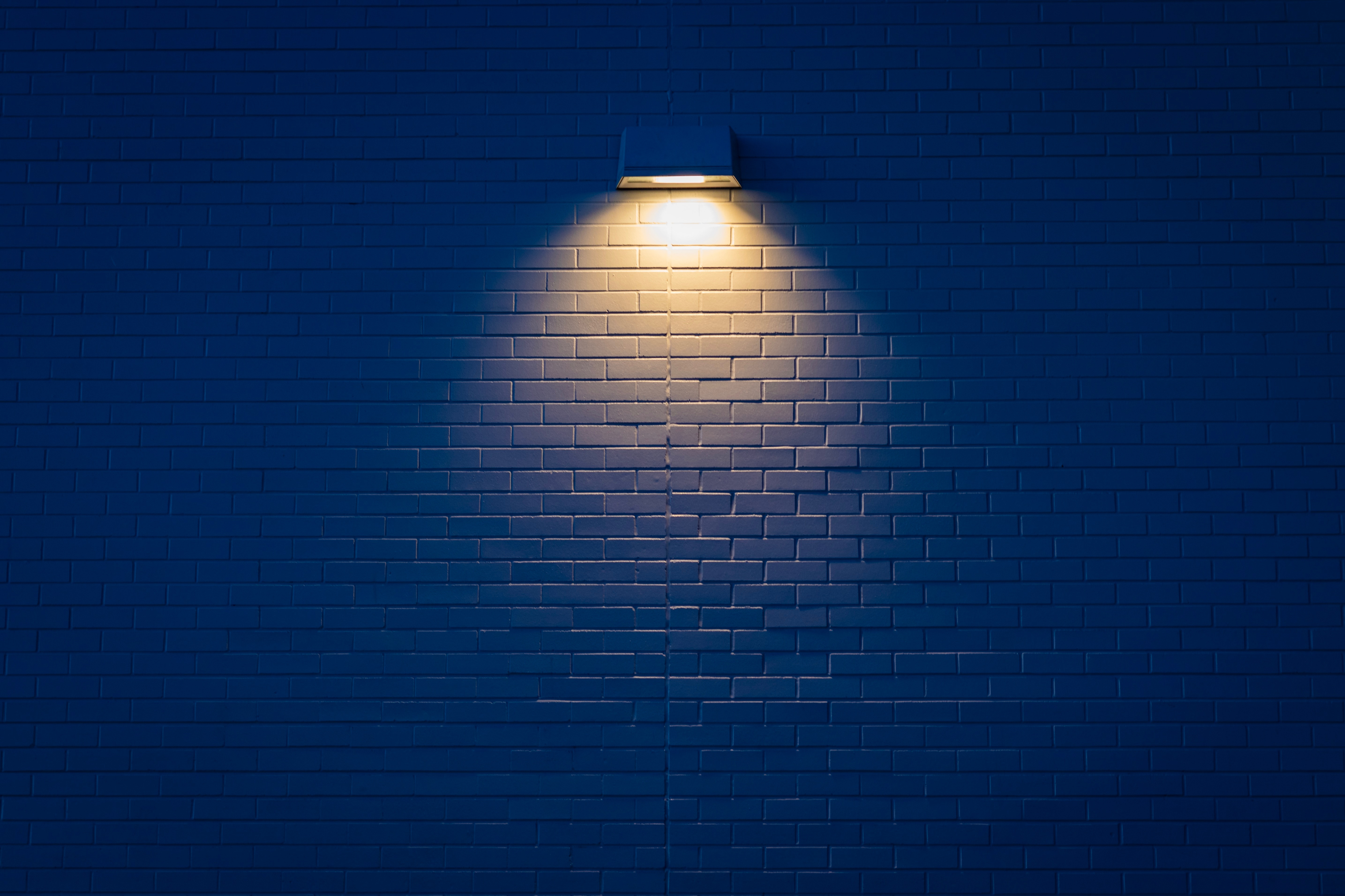 52220 download wallpaper Wall, Dark, Shine, Light, Lamp, Illumination, Lighting, Brick screensavers and pictures for free