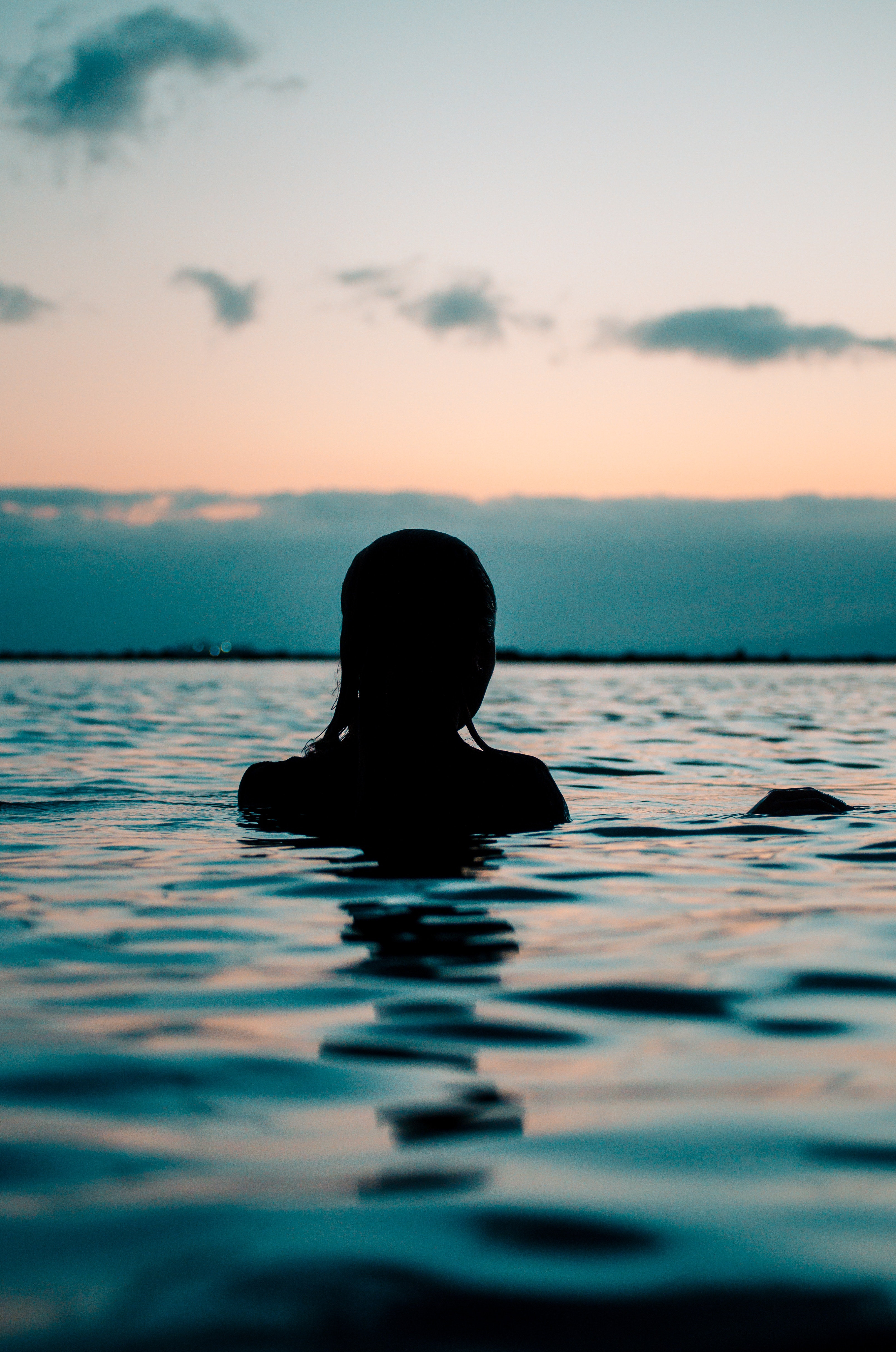 94307 download wallpaper Sunset, Sea, Swimming, Dark, Silhouette, Ripples, Ripple screensavers and pictures for free