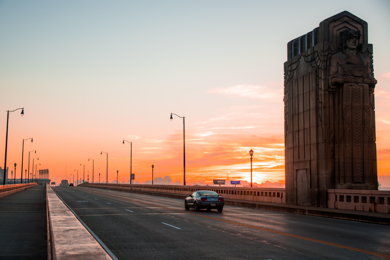 128676 Заставки и Обои Автомобиль на телефон. Скачать Автомобиль, Города, Закат, Движение, Мост, Сша, Огайо, Кливленд картинки бесплатно