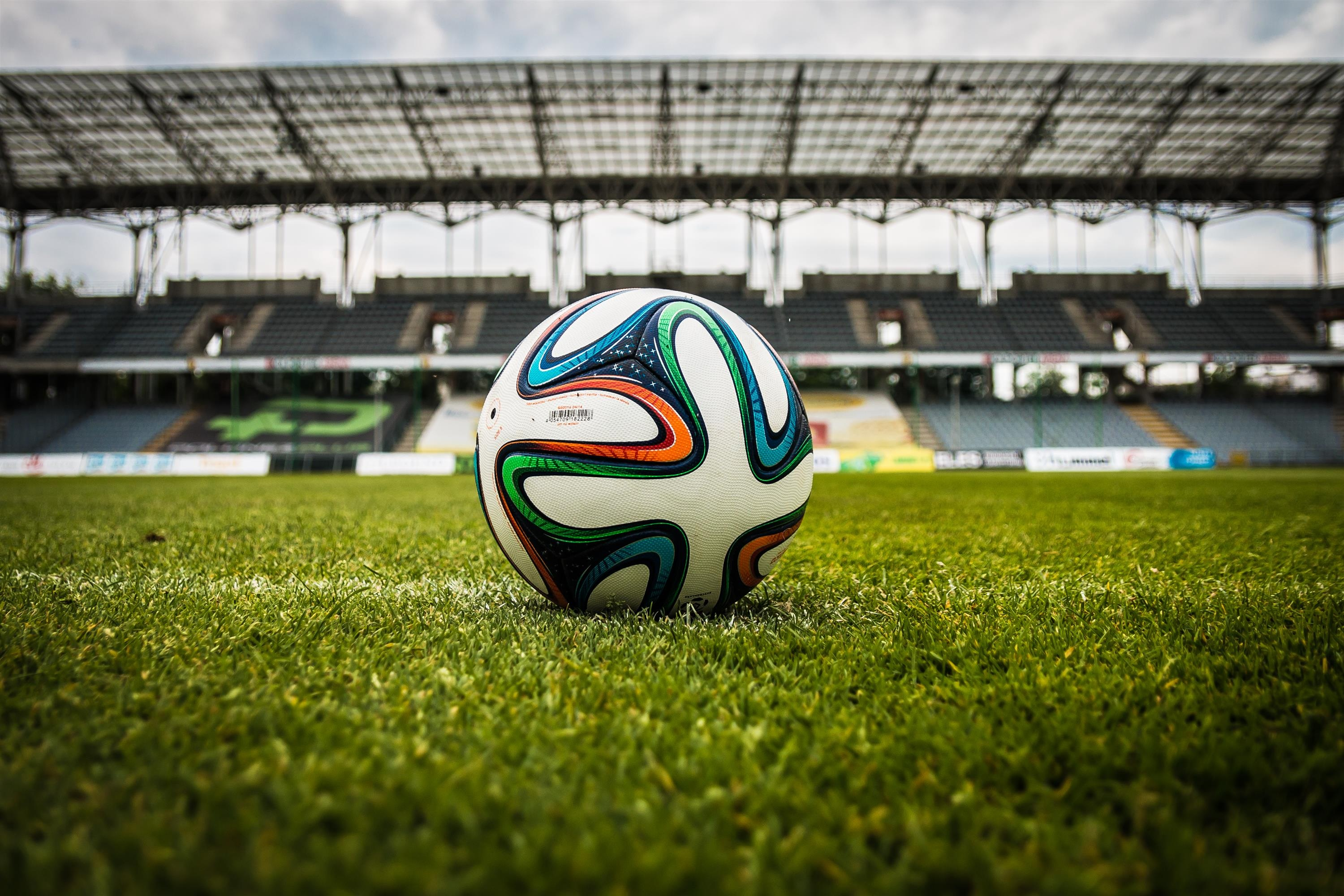 61021 download wallpaper Sports, Football, Ball, Lawn, Stadium screensavers and pictures for free