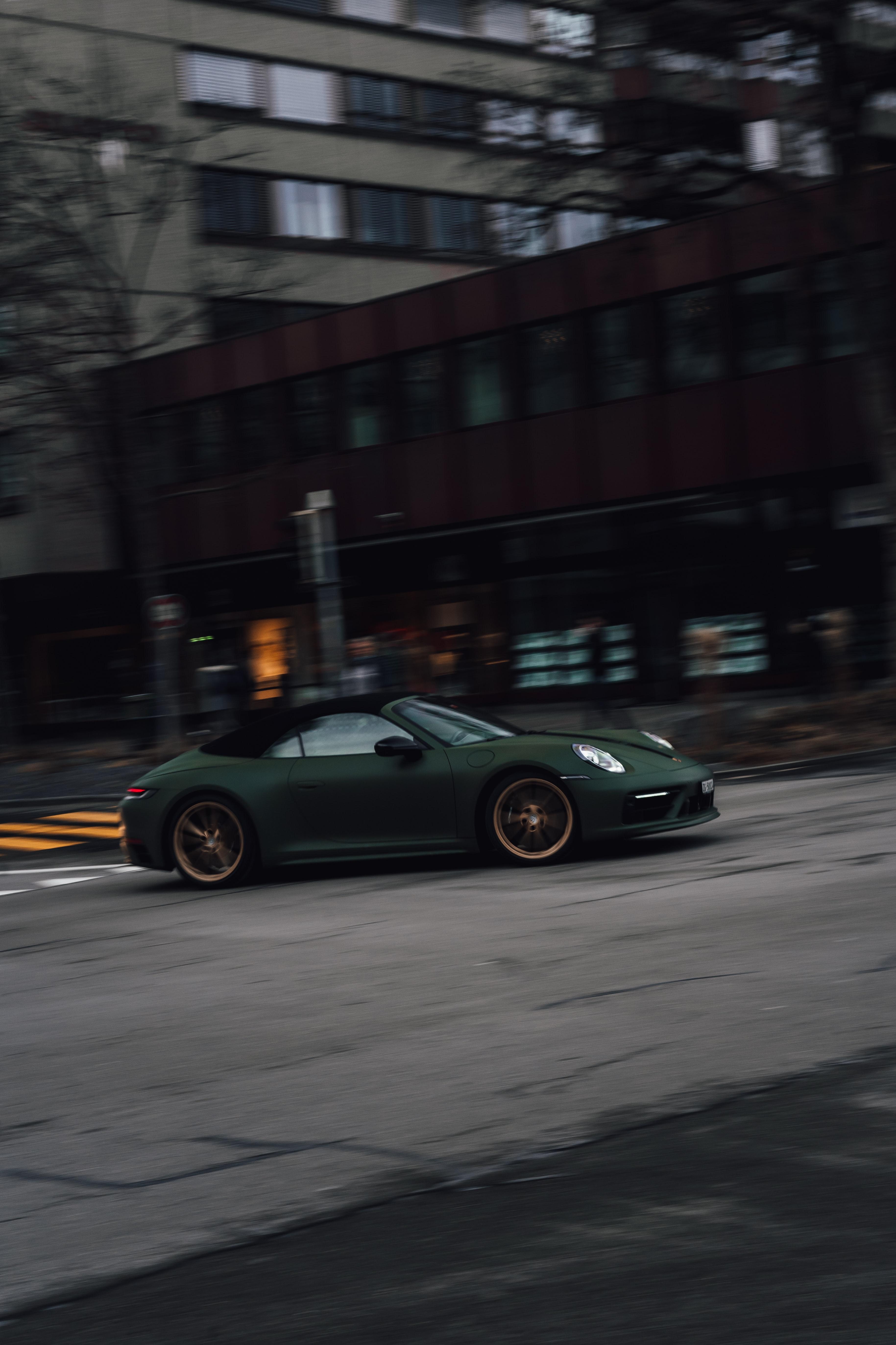 120897 Заставки и Обои Порш (Porsche) на телефон. Скачать Порш (Porsche), Тачки (Cars), Автомобиль, Спорткар, Зеленый, Скорость, Улица картинки бесплатно