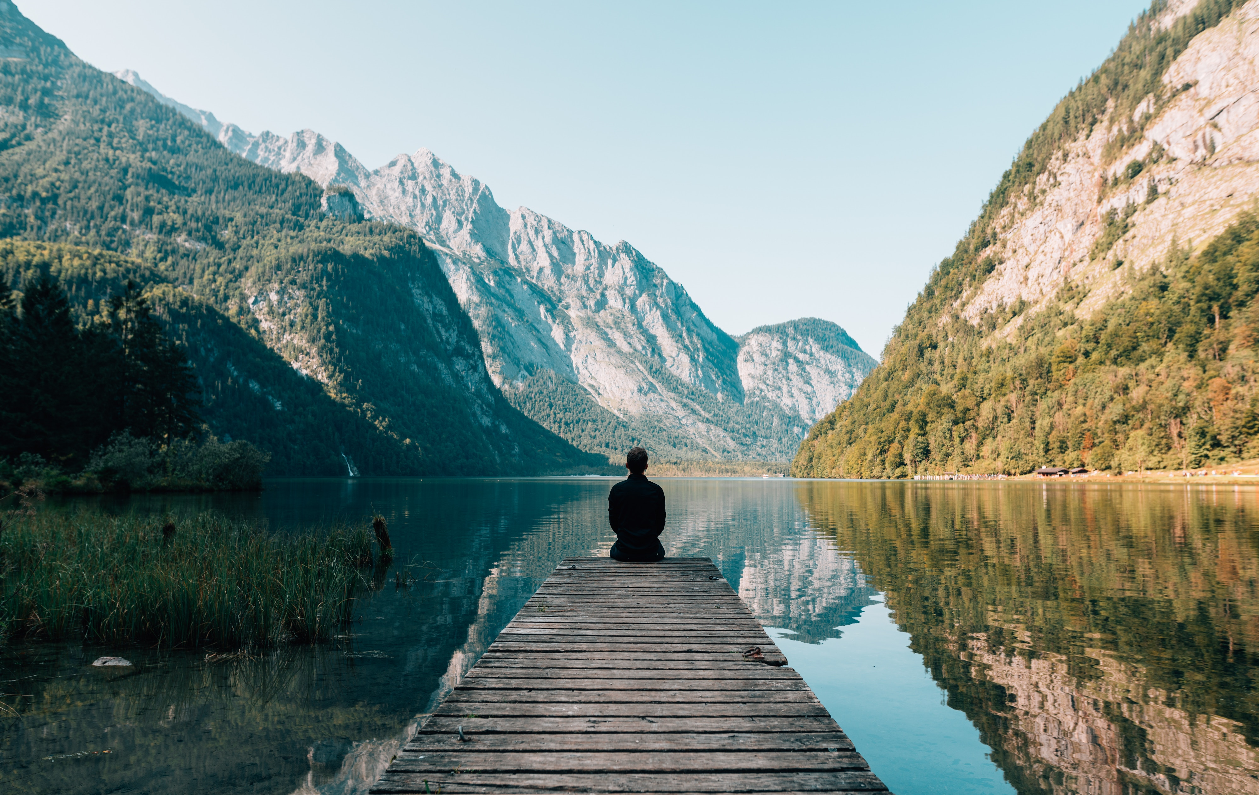 138565 download wallpaper Nature, Human, Person, Berth, Wharf, Loneliness, Silence, Mountains screensavers and pictures for free