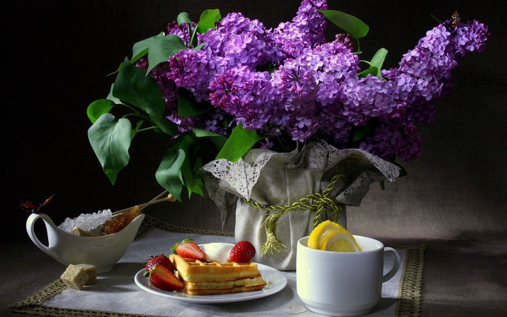 81977 download wallpaper Butterflies, Flowers, Food, Strawberry, Lilac, Waffles, Still Life, Cup, Dark Background, Lemon, Napkin, Breakfast, Sugar screensavers and pictures for free
