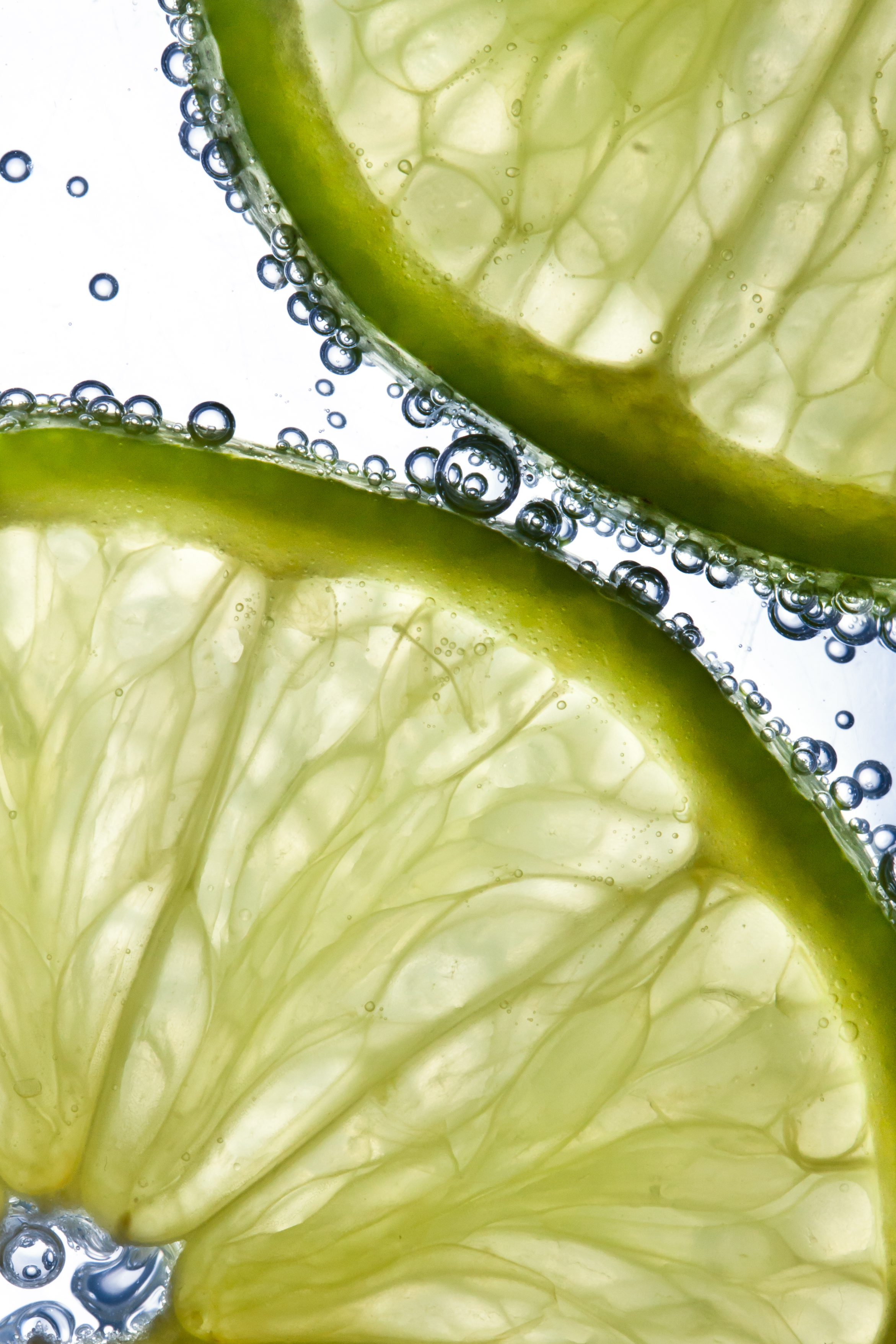 129863 download wallpaper Water, Food, Bubbles, Lime, Citrus, Lobules, Slices screensavers and pictures for free