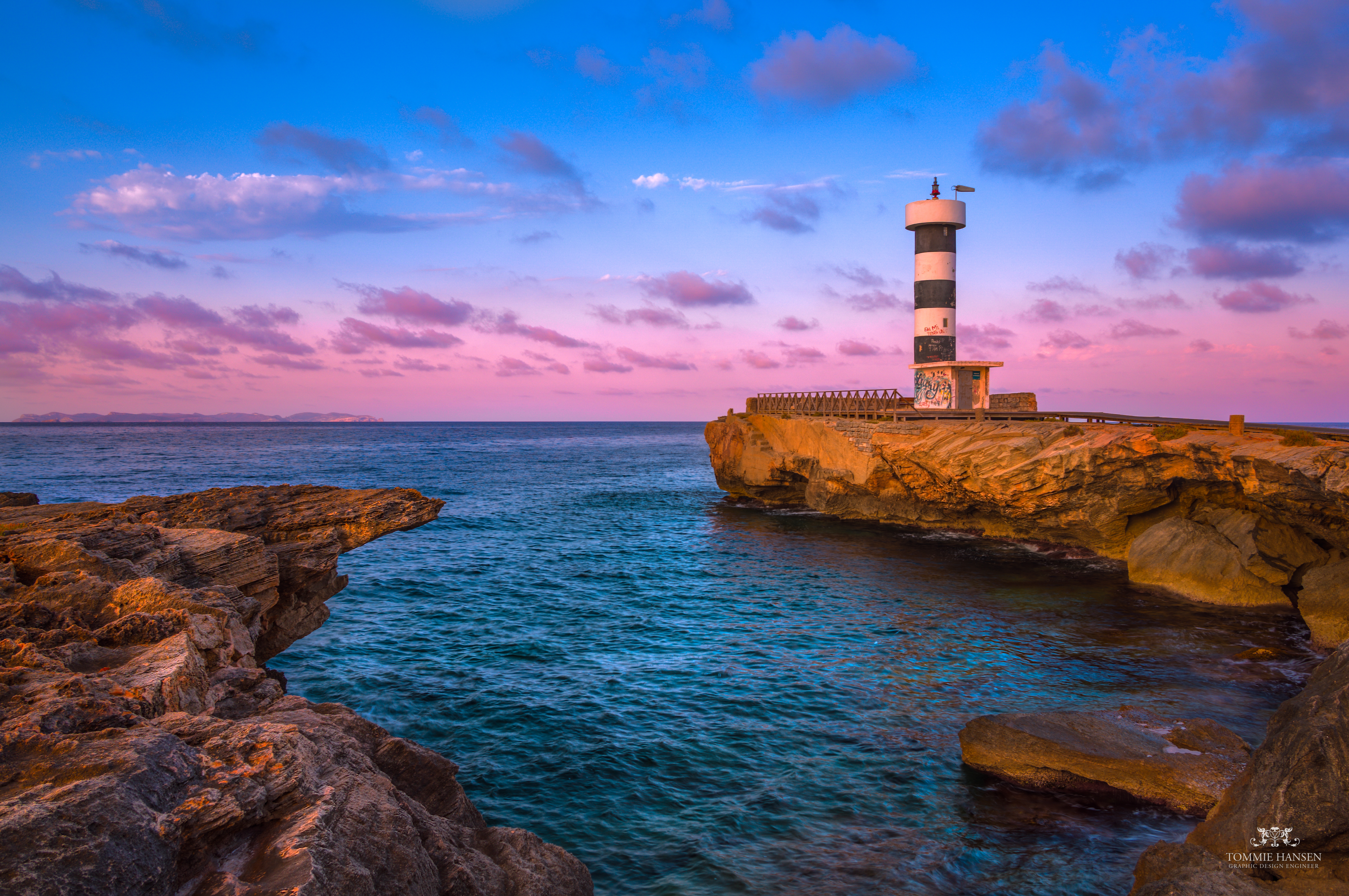 141044 Screensavers and Wallpapers Rocks for phone. Download Nature, Sea, Dawn, Rocks, Lighthouse, Bay, Spain pictures for free