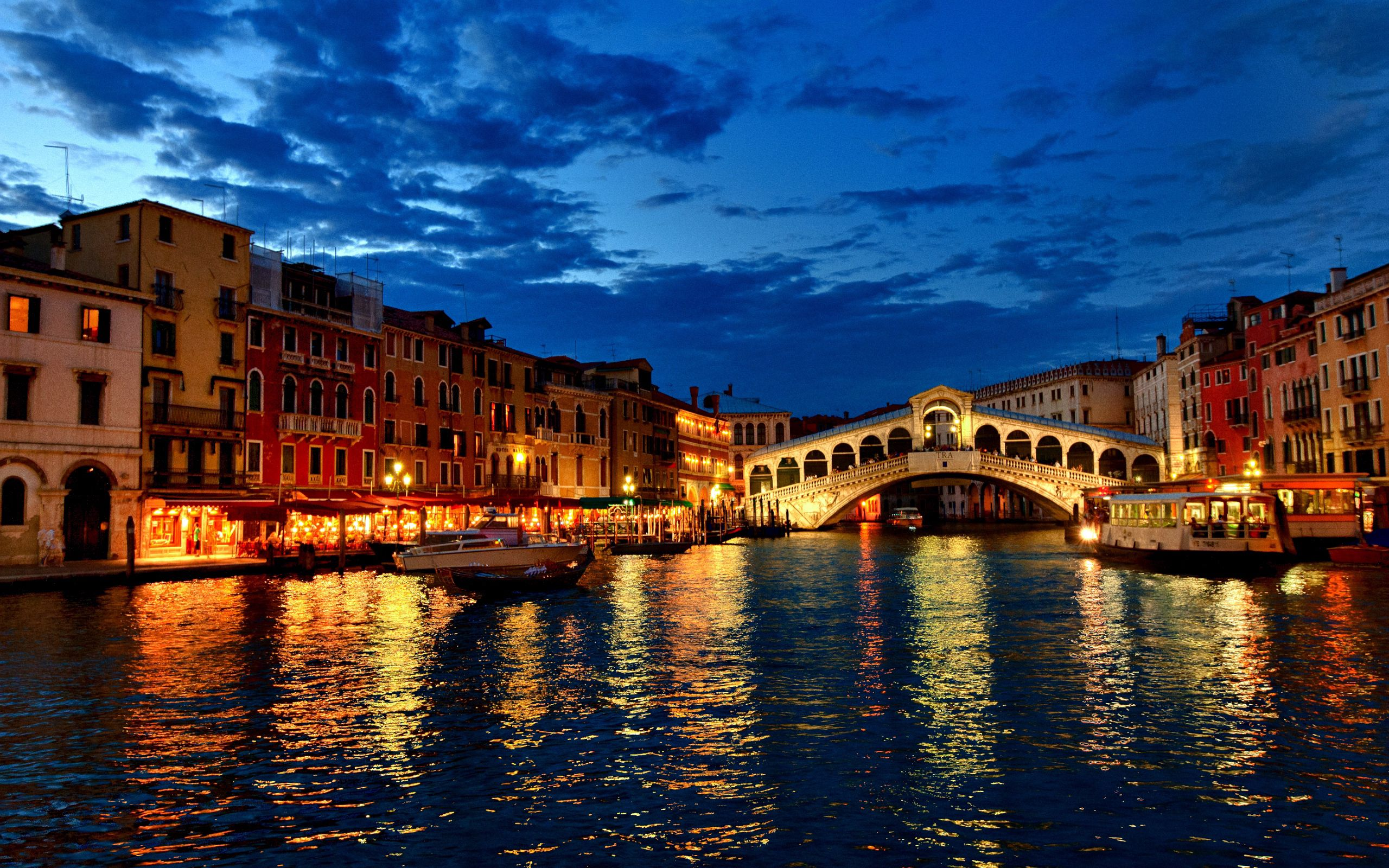 158099 Screensavers and Wallpapers Houses for phone. Download Channel, Gondola, Boats, Evening, Lights, Houses, Clouds, Italy, Cities, Venice pictures for free