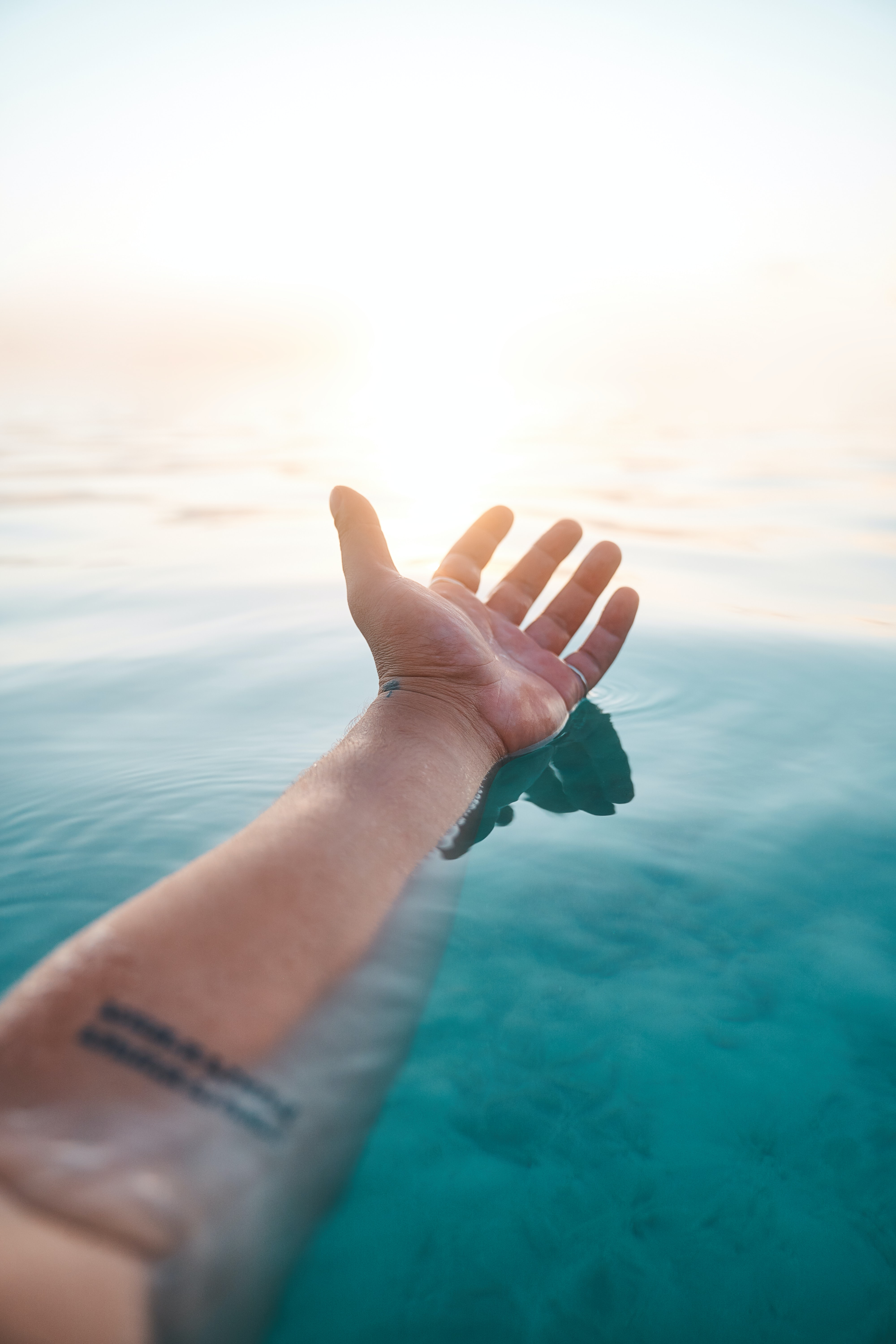 145741 download wallpaper Miscellanea, Miscellaneous, Hand, Water, Beams, Rays, Sun screensavers and pictures for free