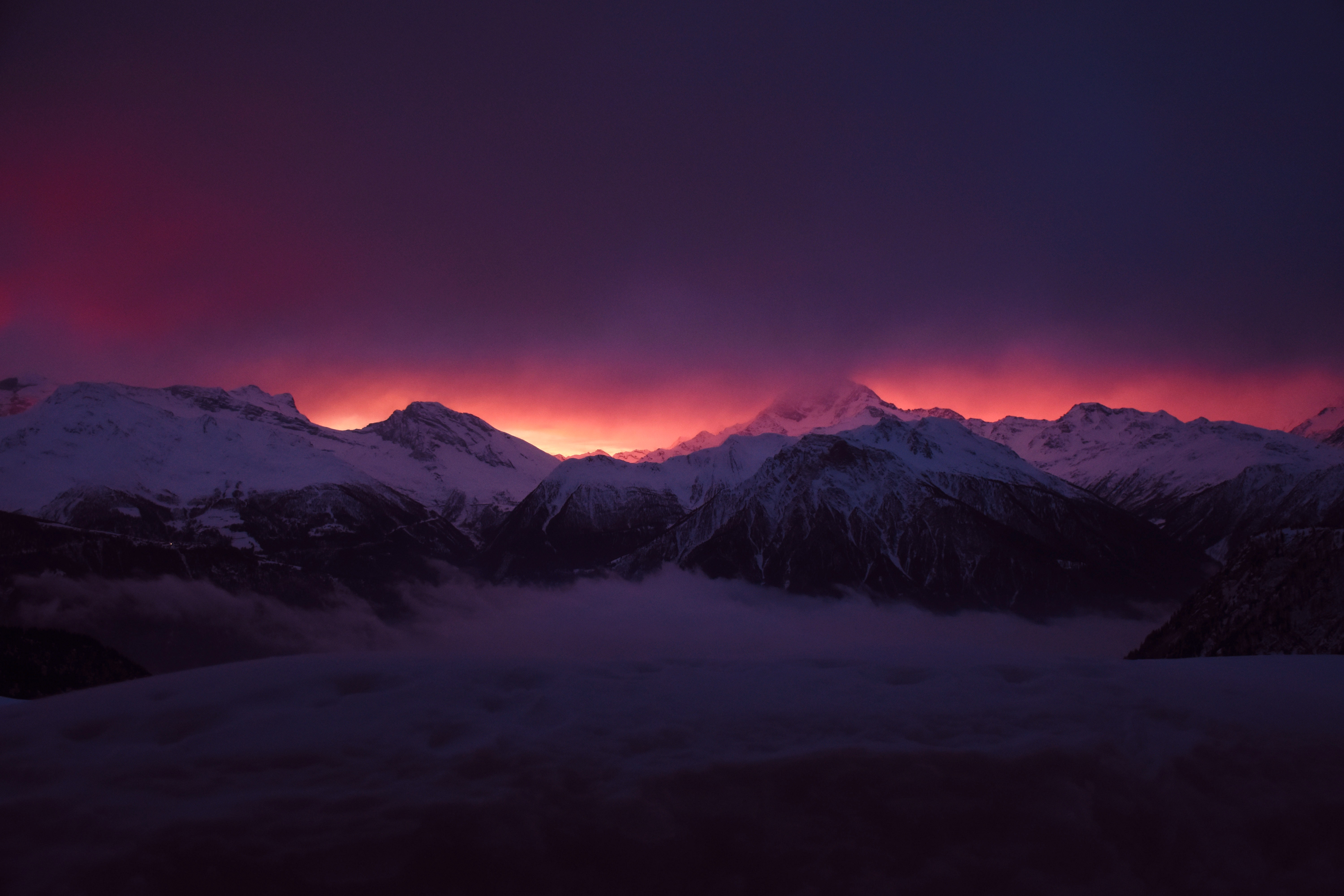 85344 download wallpaper Dark, Sky, Nature, Sunset, Mountains, Clouds, Fog, Snow Covered, Snowbound, Vertices screensavers and pictures for free