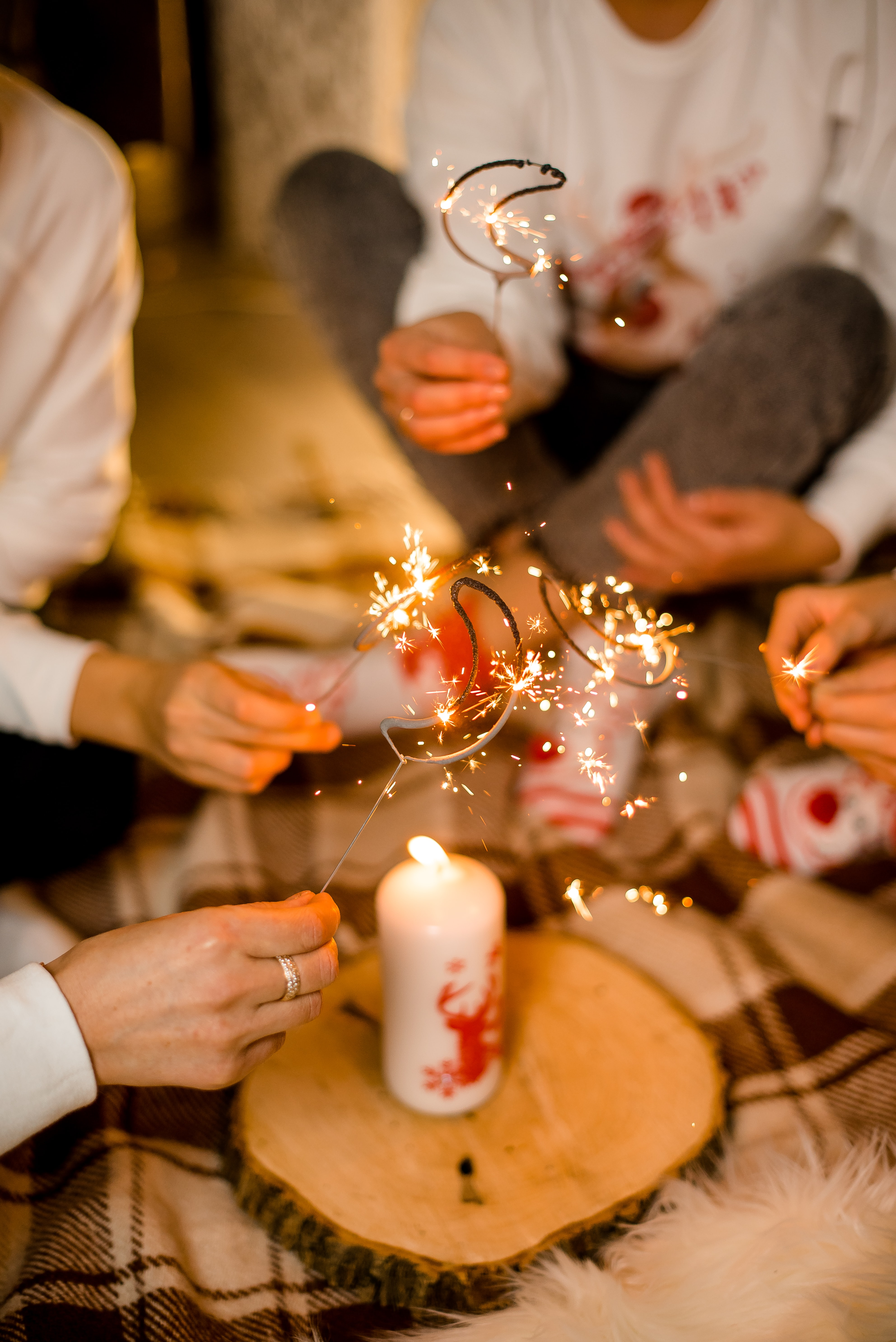 119794 download wallpaper People, Holidays, Sparks, Holiday, Bengal Lights, Sparklers, Candle screensavers and pictures for free