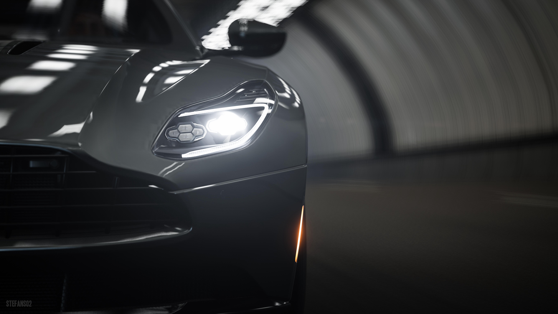 88821 Заставки и Обои Астон Мартин (Aston Martin) на телефон. Скачать Астон Мартин (Aston Martin), Тачки (Cars), Вид Спереди, Серый, Крупный План, Спорткар, Фара, Aston Martin Db11 картинки бесплатно