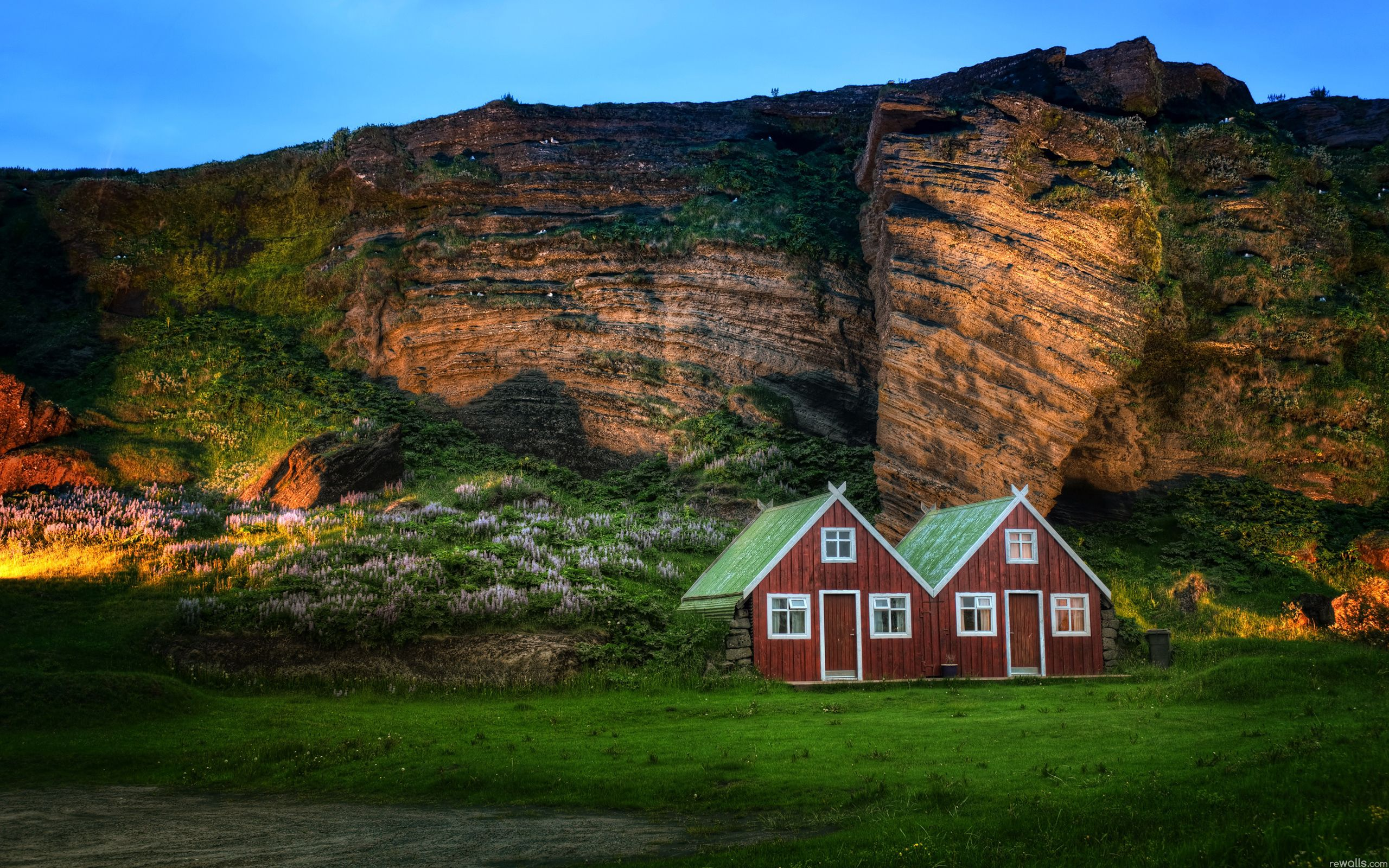 63577 download wallpaper Nature, Houses, Rock, Mountain, Shine, Light, Iceland, Meadow, Small Houses screensavers and pictures for free