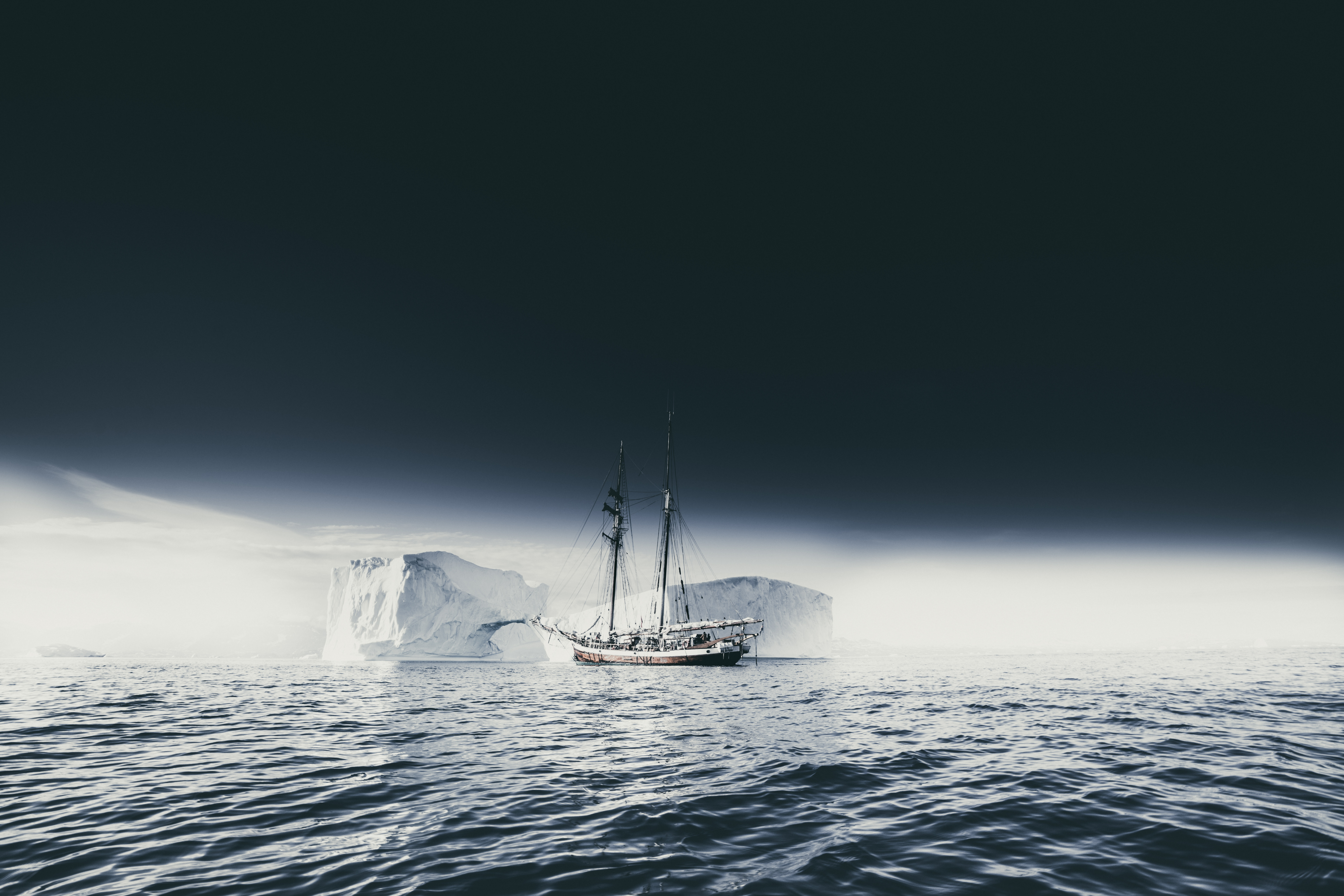149055 download wallpaper Sky, Nature, Sea, Ice, Fog, Ship, Ice Floes, Iceberg screensavers and pictures for free