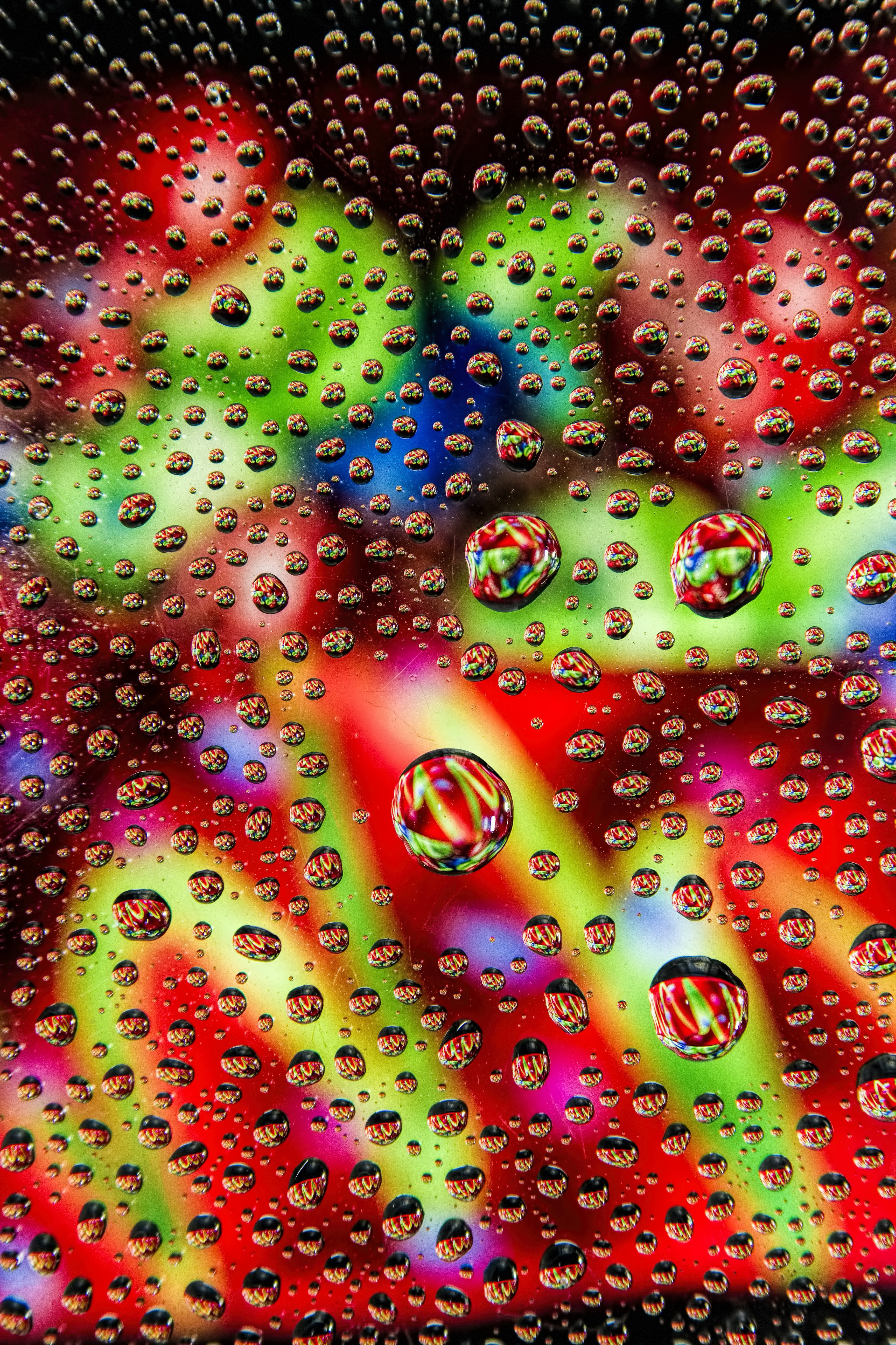 120041 download wallpaper Macro, Drops, Multicolored, Motley, Liquid, Surface, Bubbles screensavers and pictures for free