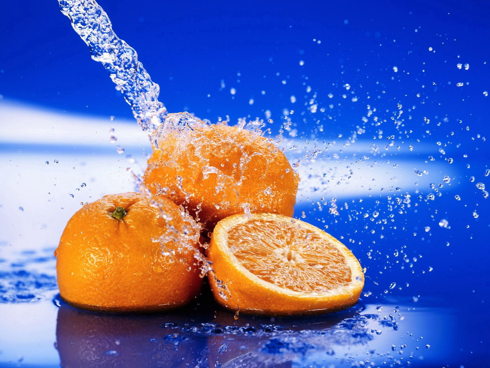 87637 download wallpaper Water, Food, Spray, Fruit, Slice, Section screensavers and pictures for free