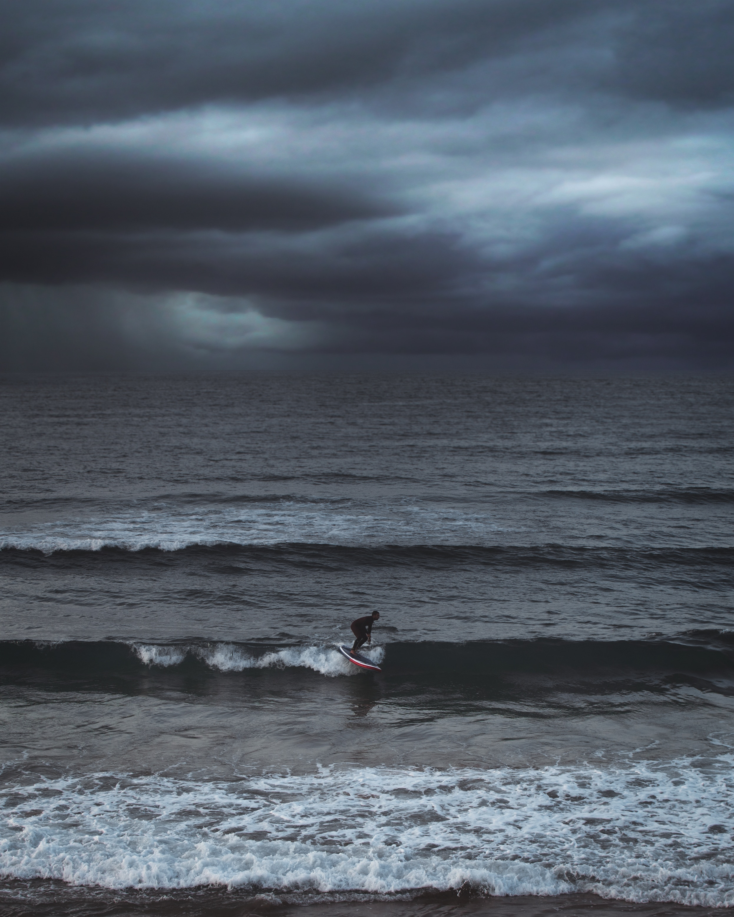 133465 download wallpaper Sports, Surfer, Serfing, Sea, Ocean, Mainly Cloudy, Overcast, Waves screensavers and pictures for free