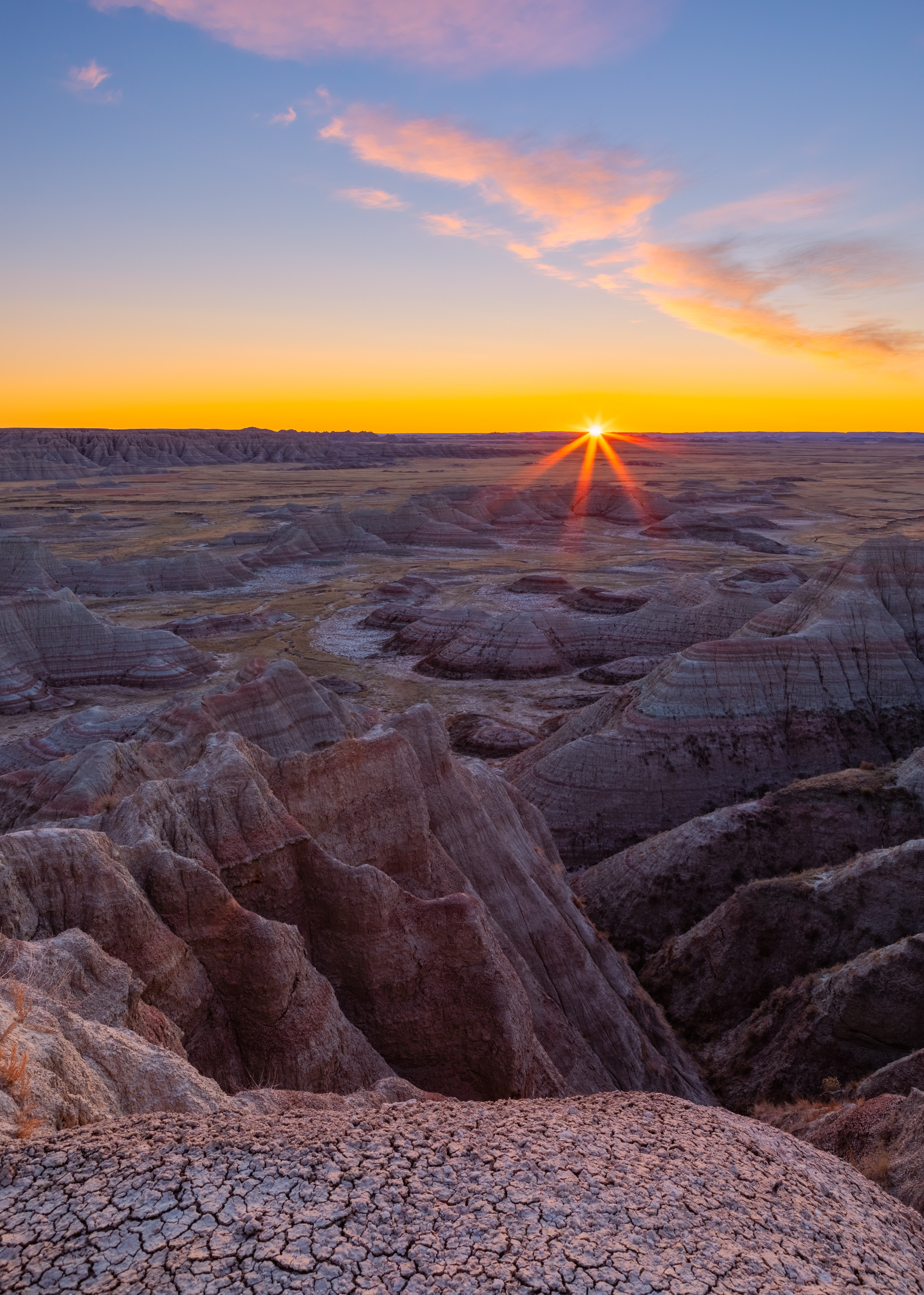 108862 download wallpaper Nature, Canyon, Rocks, Dry, Cracks, Crack, Sunset, Sun screensavers and pictures for free