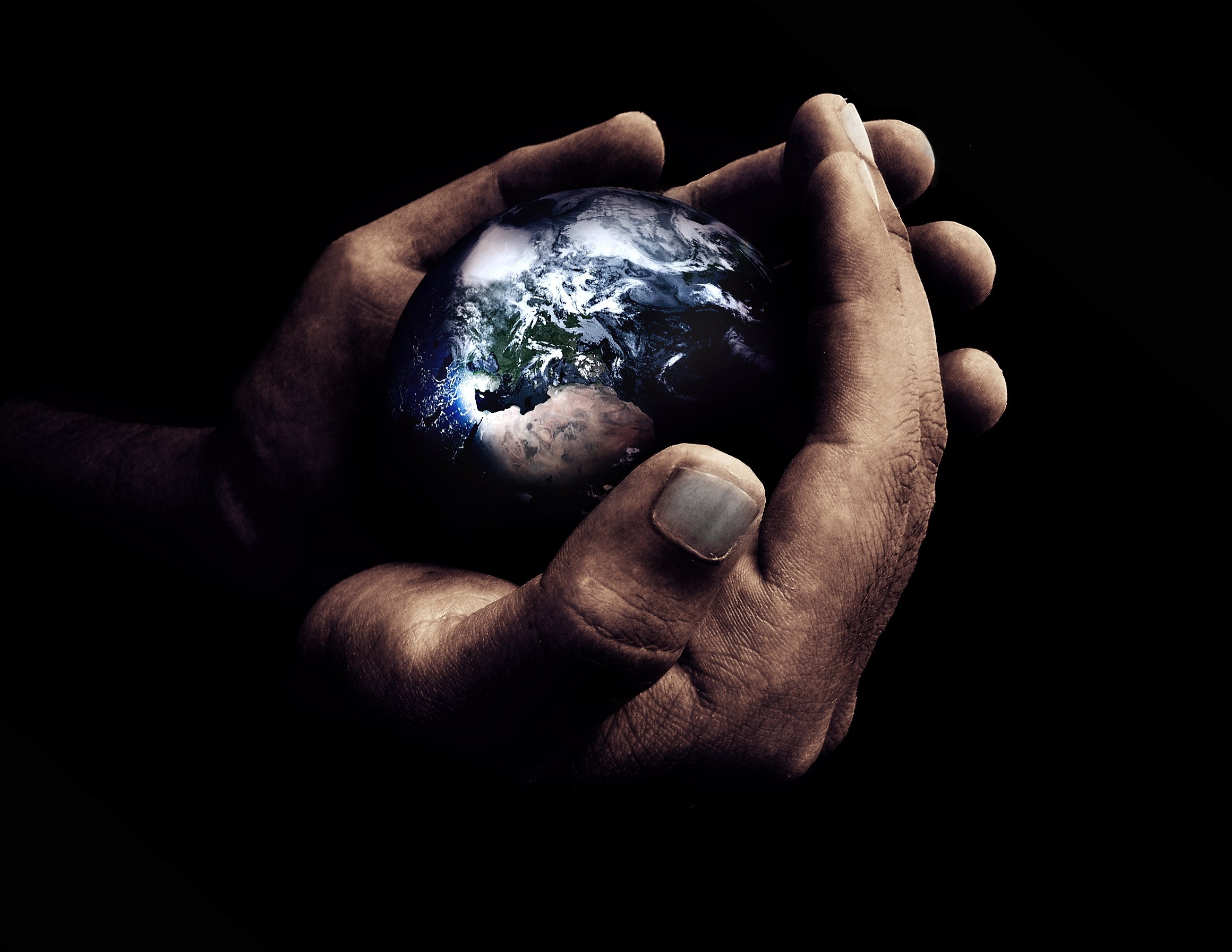 135103 download wallpaper Dark, Hands, Planet, Palms, Palm screensavers and pictures for free