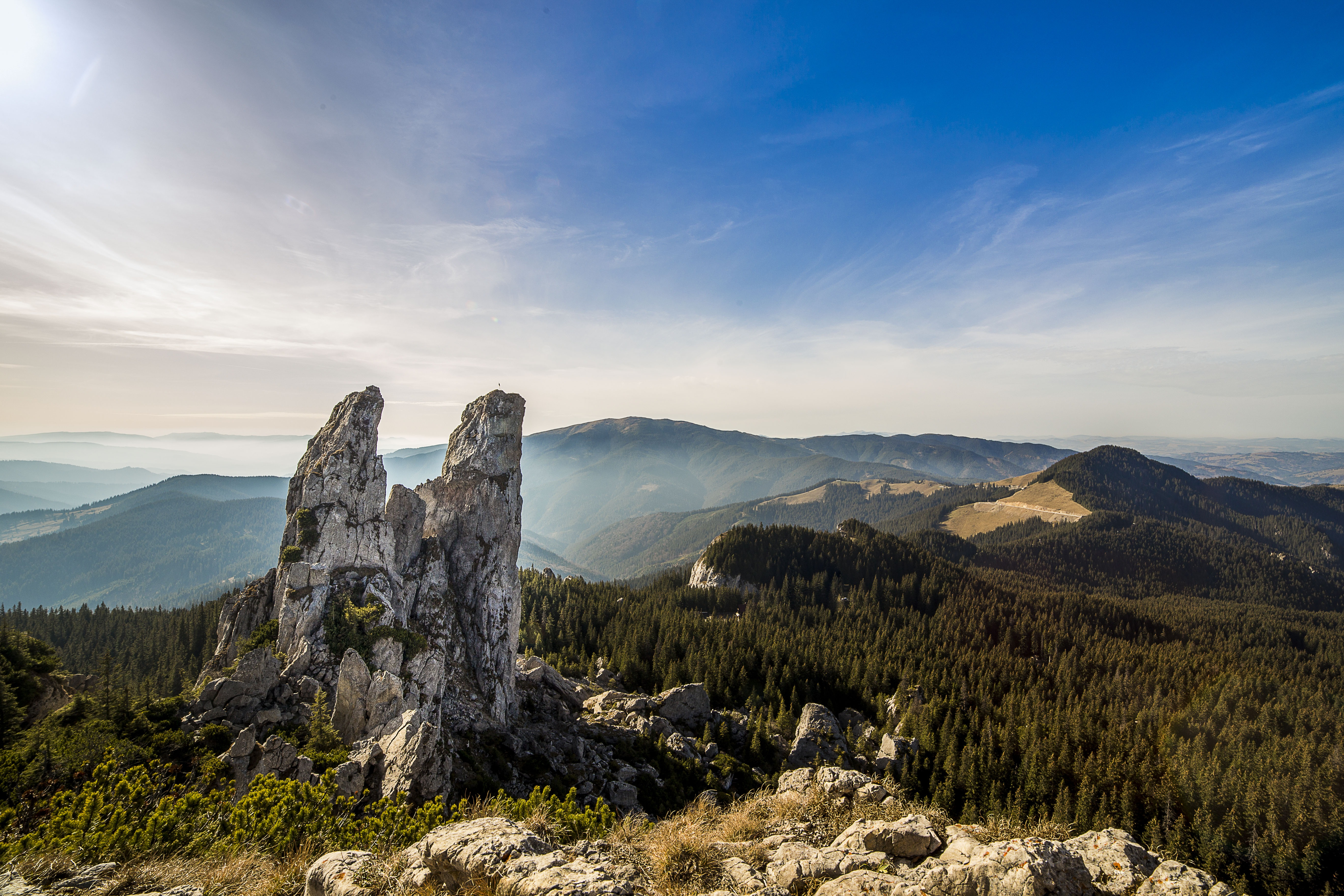 139351 download wallpaper Nature, Romania, Stones, Sky, Trees, Mountains screensavers and pictures for free