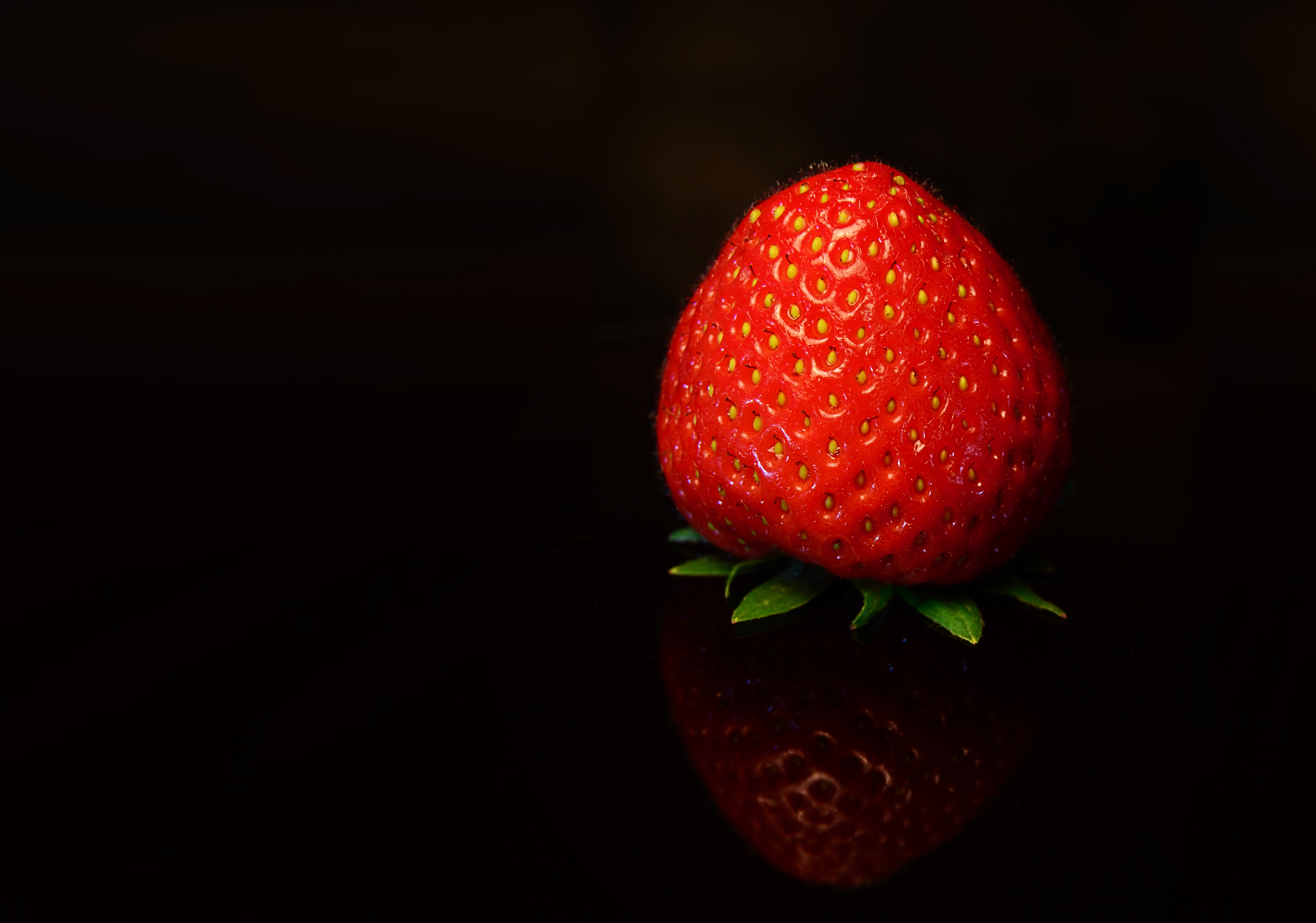 133882 download wallpaper Food, Strawberry, Berry, Black Background screensavers and pictures for free